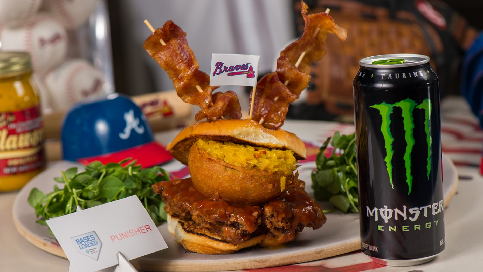"""The Atlanta Braves want to """"punish"""" you with this giant sandwich glazed with Monster energy-drink infused barbecue sauce."""