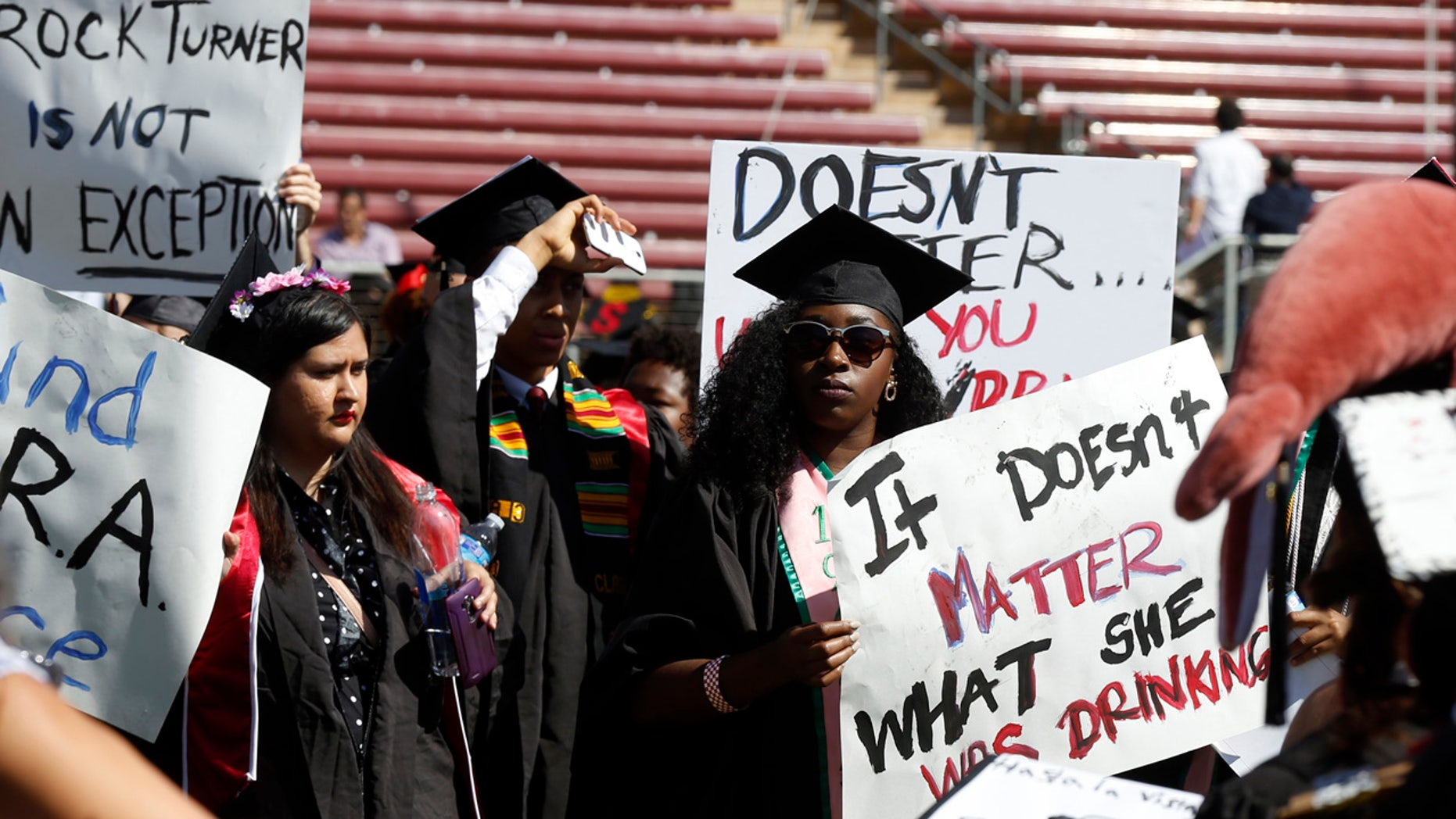 June 12, 2016: Protesters demonstrate during Stanford University graduation exercises at Stanford Stadium in Stanford, Calif.