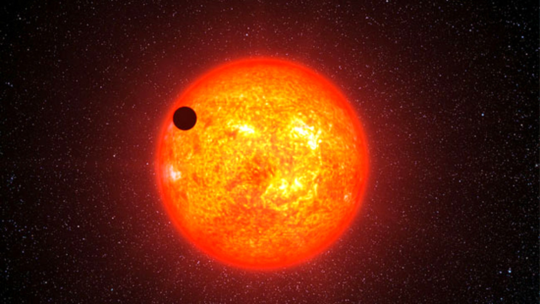 The alien planet GJ 1214b passes in front of its host star in this artist�s impression. The so-called transit of the planet in front of the star allowed scientists to probe its atmosphere for the first time.