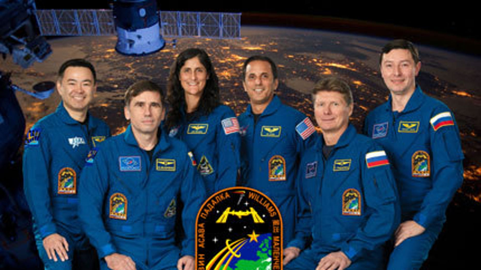 Pictured from the left are Flight Engineers Akihiko Hoshide, Yuri Malenchenko, Sunita Williams and Joe Acaba, Commander Gennady Padalka and Flight Engineer Sergei Revin.