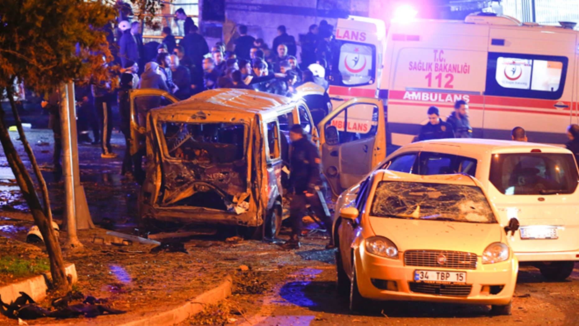 Police arrive at the site of a car bombing attack in Istanbul, Turkey