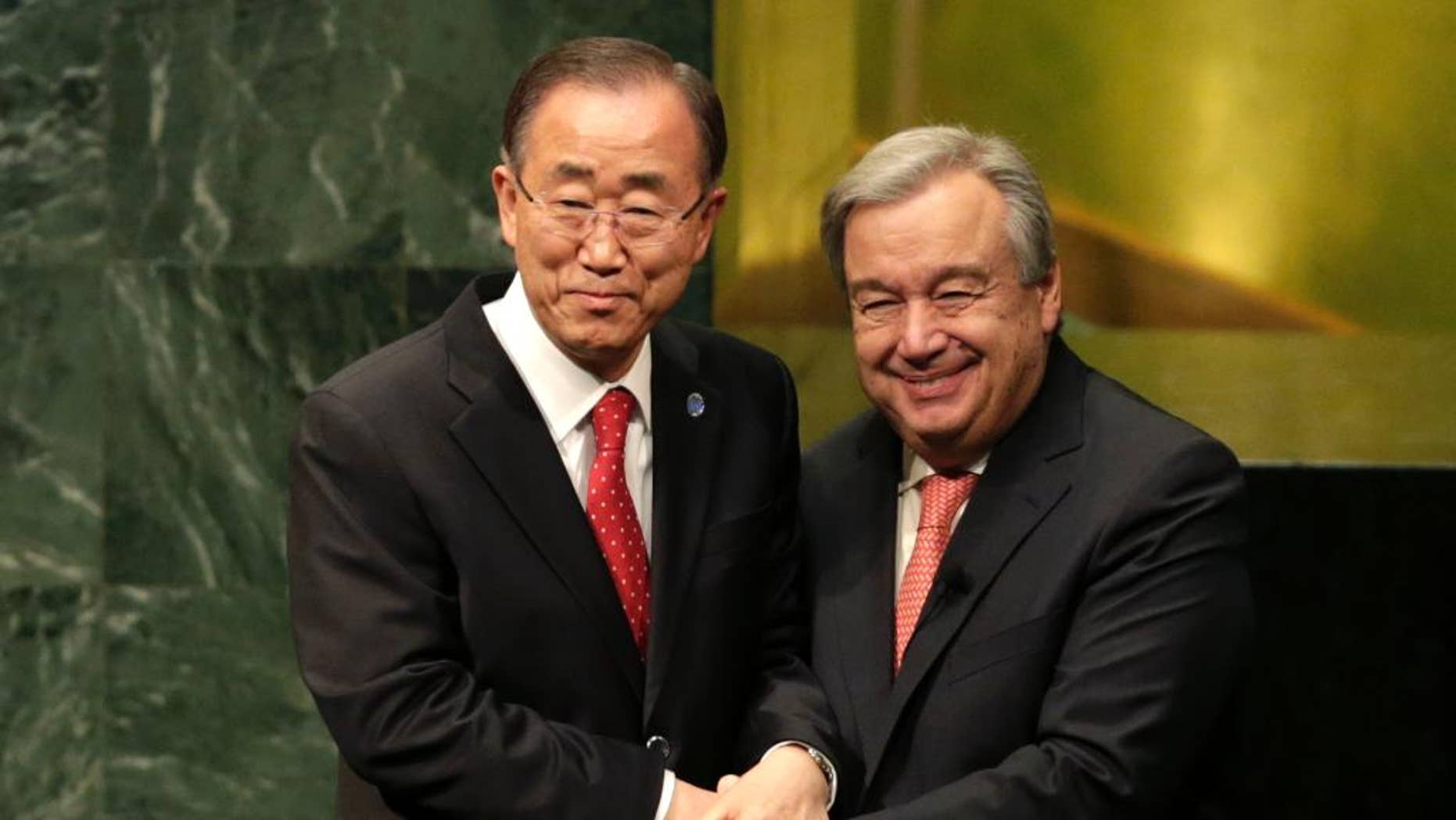 Current Secretary-General Ban Ki-moon, left, clasps hands with U.N. Secretary-General designate Antonio Guterres after Guterres was sworn in at U.N. headquarters, Monday, Dec. 12, 2016. (AP Photo/Seth Wenig)
