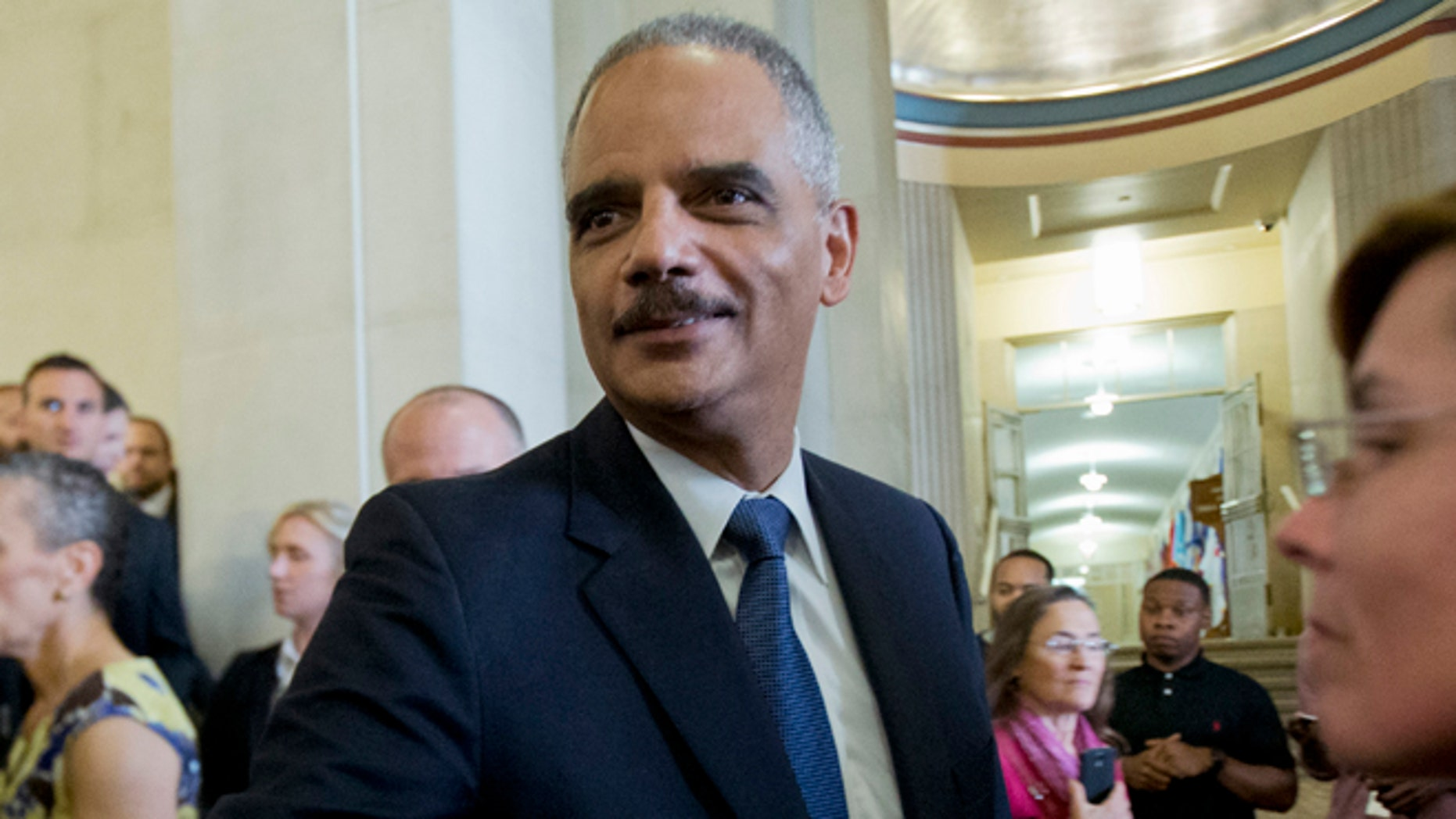 April 24, 2015: Attorney General Eric Holder bids goodbye to Justice Department employees as they leave the Justice Department in Washington.
