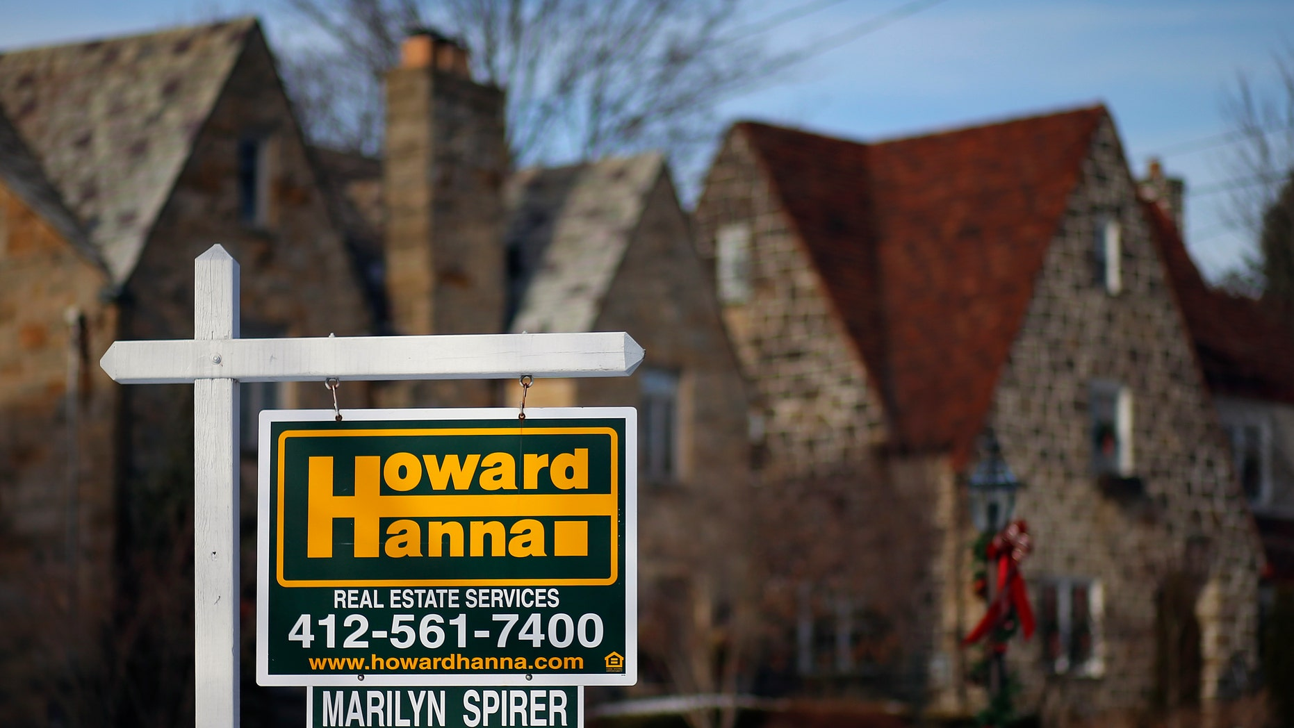 In this Thursday, Jan. 9, 2014, photo, a for sale sign hangs in front of a house in Mount Lebanon, Pa. The National Association of Realtors releases existing home sales for December, on Thursday, Jan. 23, 2014. (AP Photo/Gene J. Puskar)