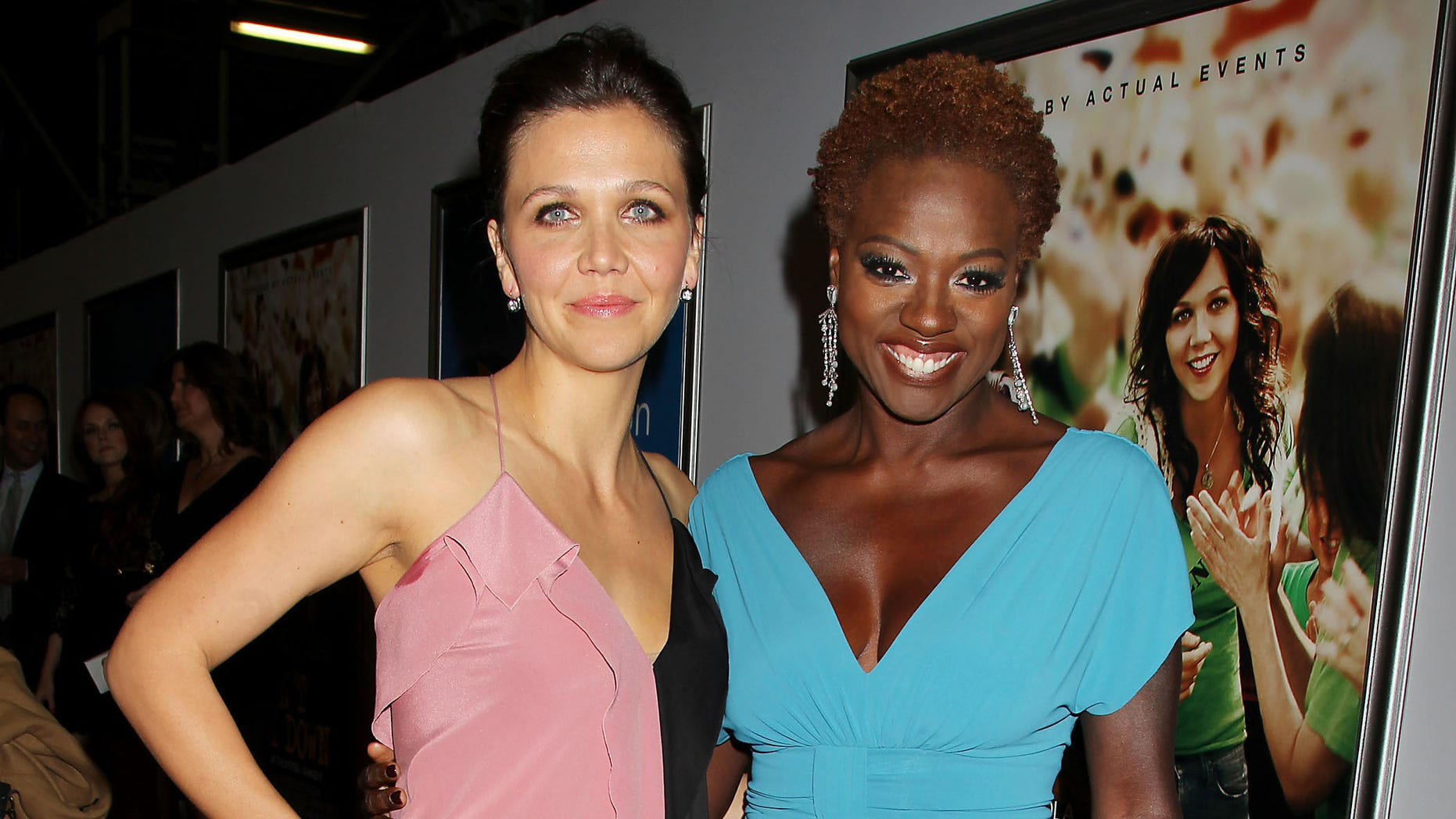 """FILE - This Sept. 23, 2012 file photo released by Starpix shows actress Maggie Gyllenhaal, left, and Viola Davis at the premiere of their film """"Won't Back Down,"""" in New York. The movie was a box-office dud, but its creators have more than ticket sales in mind.  They hope the classroom drama about two single moms in Pittsburgh trying to save their kids' failing inner-city school also sparks a wave of activism while igniting widespread legal changes giving parents more control over how their children learn. (AP Photo/Starpix, Dave Allocca, File)"""