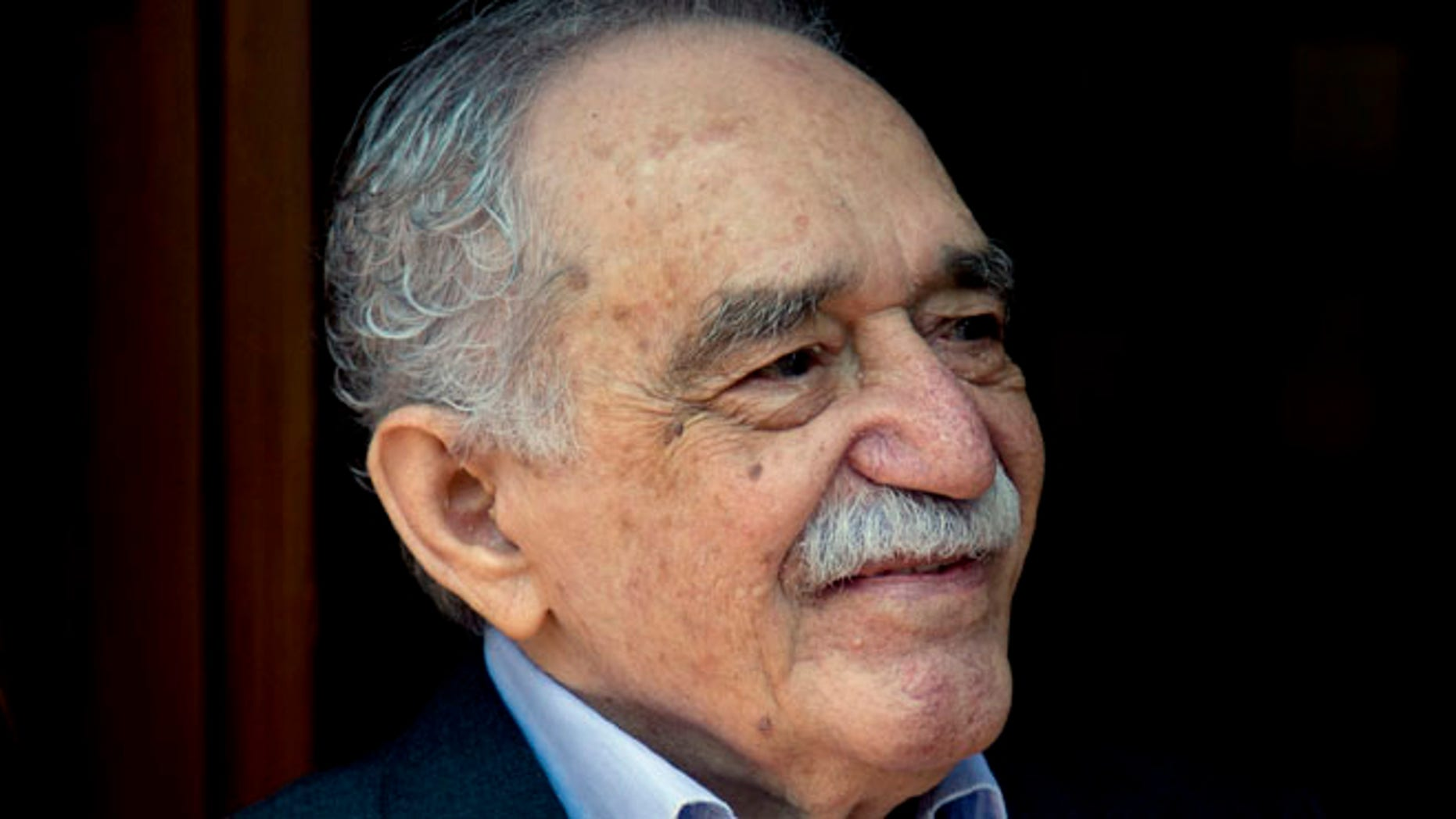 March 6, 2014 In this file photo, Colombian Nobel Literature laureate Gabriel Garcia Marquez greets fans and reporters outside his home on his 87th birthday in Mexico City.