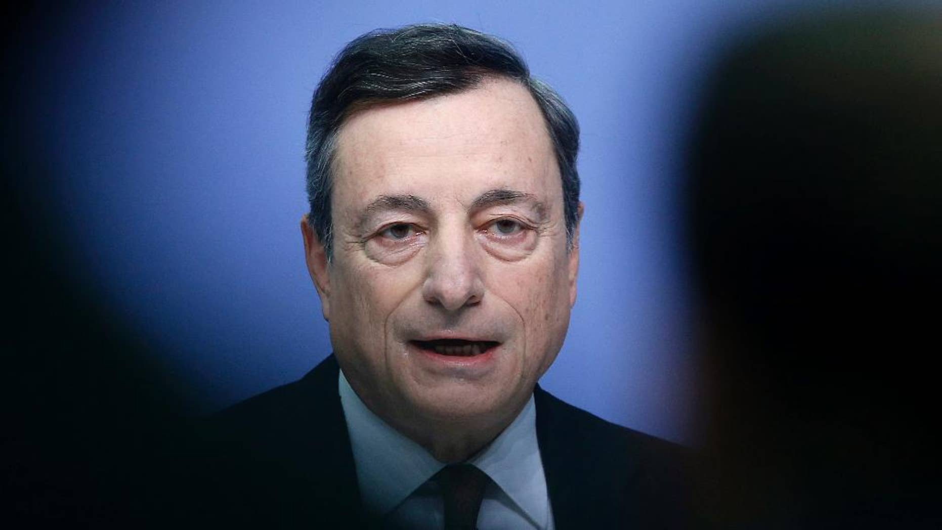 President of the European Central Bank Mario Draghi speaks during a news conference after a meeting of the governing council in Frankfurt, Germany, Thursday, Jan. 19, 2017. (AP Photo/Michael Probst)