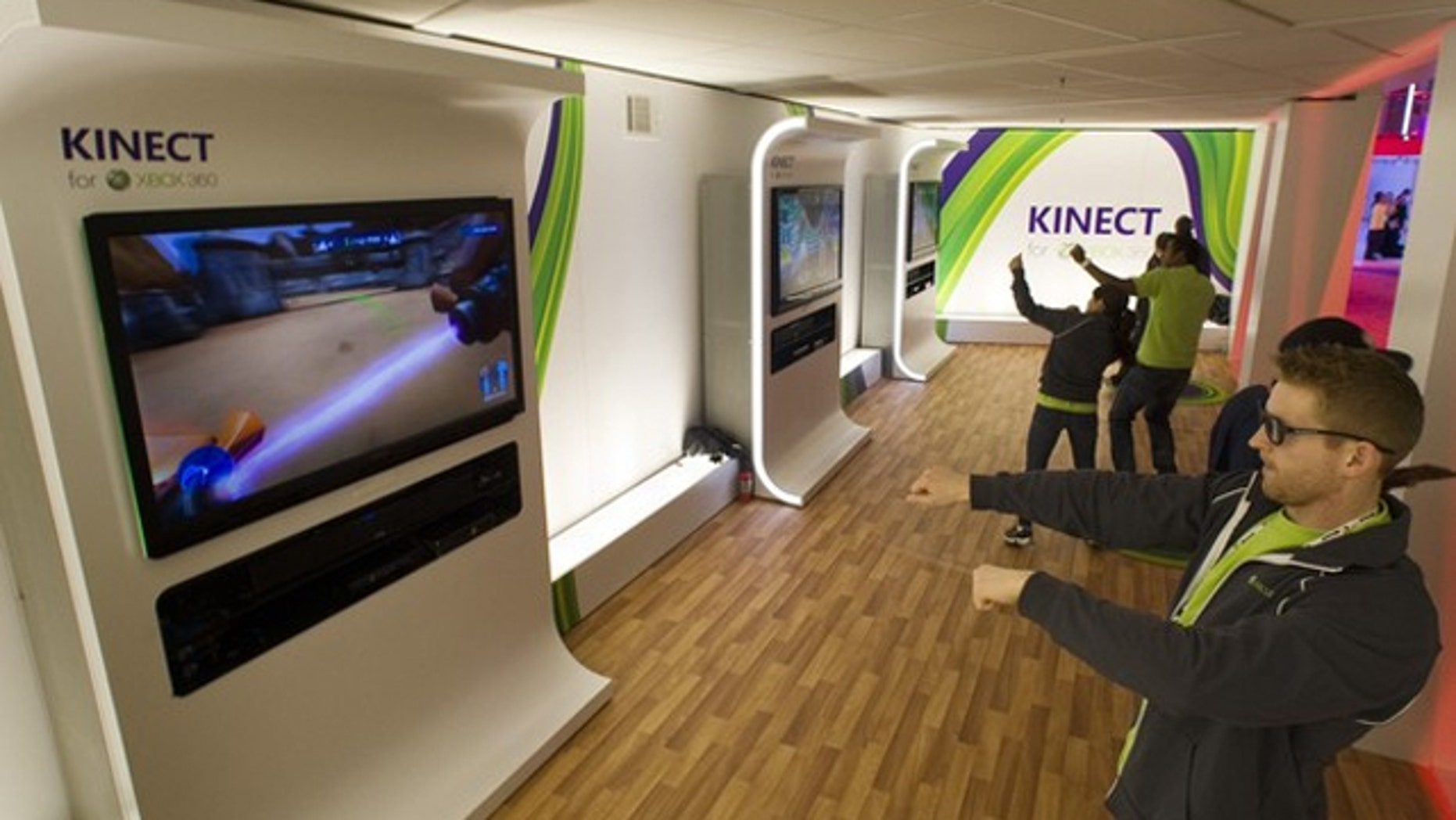 Gamers test out Microsoft's Xbox Kinect.