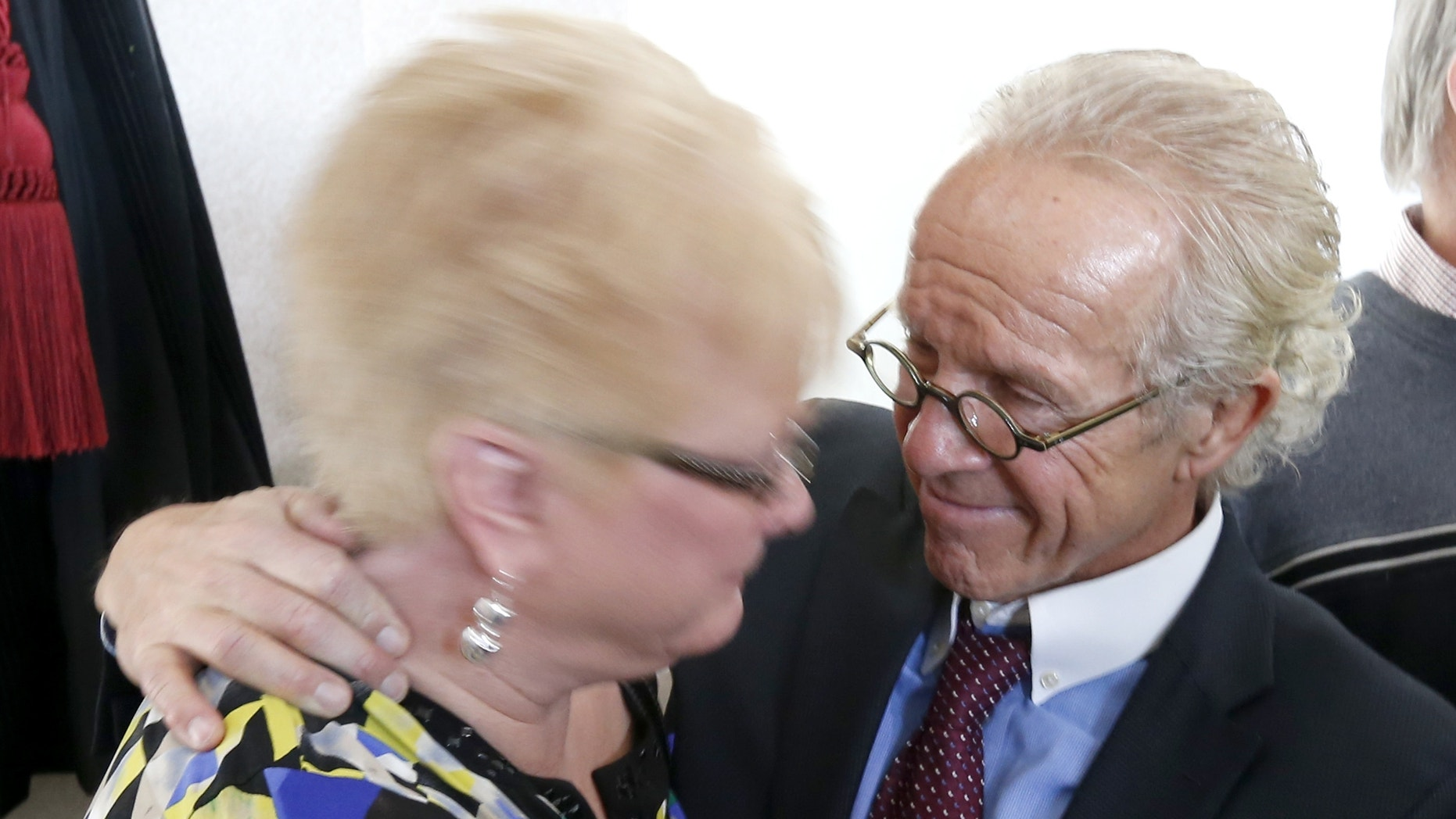 Jan. 21, 2014: Attorney Jeff Anderson, right, smiles after hugging Kathy Laarveld, whose son was sexually abused by a priest, after a news conference on the release of files of Catholic priests credibly accused of sexually abusing minors in the Archdiocese of Chicago, in Chicago.