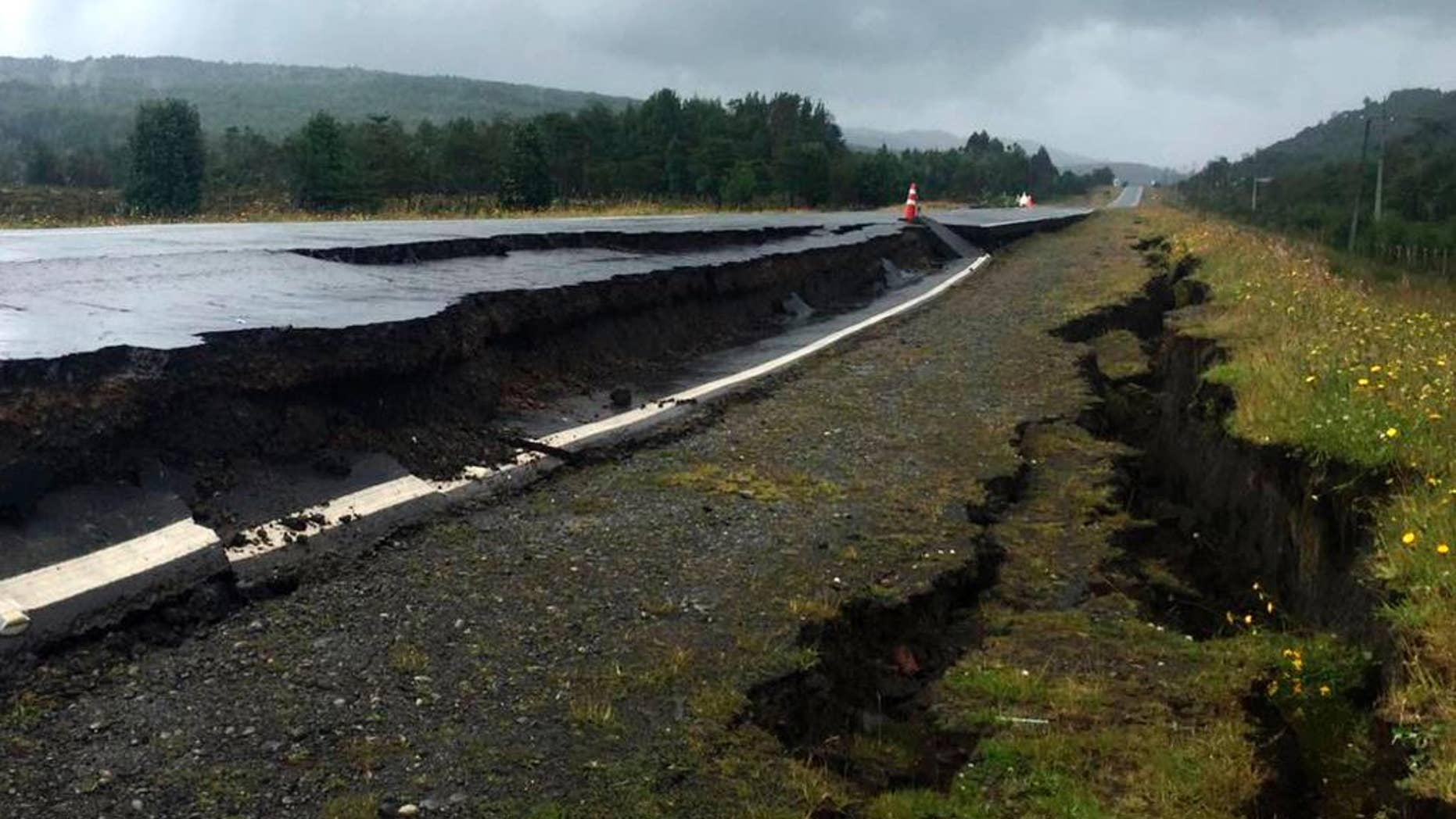 Cracks appear in and along a road near Quellon, Chile, Sunday, Dec. 25, 2016, after an earthquake. (Edinson Capdevilla/Aton via AP)
