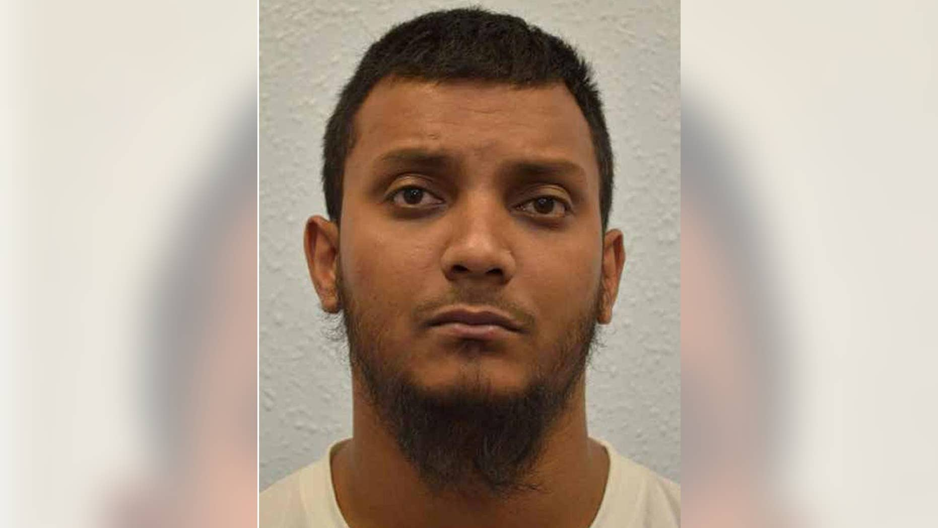 This is an undated handout file photo issued by the Crown Prosecution Service of Junead Khan. Khan a British delivery driver was Friday May 13, 2016 sentenced to at least 12 years prison for an Islamic State group-inspired plot to attack American military personnel in the U.K.  .  (Crown Prosecution Service via AP) NOTE TO EDITORS: This handout photo may only be used in for editorial reporting purposes for the contemporaneous illustration of events, things or the people in the image or facts mentioned in the caption. Reuse of the picture may require further permission from the copyright holder.
