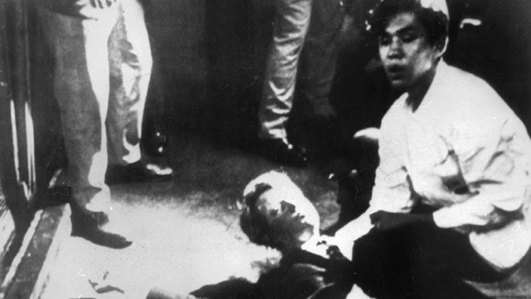 Robert F. Kennedy on the floor after being shot, with a 17-year-old Juan Romero cradling his head. (Photo: Getty Images)