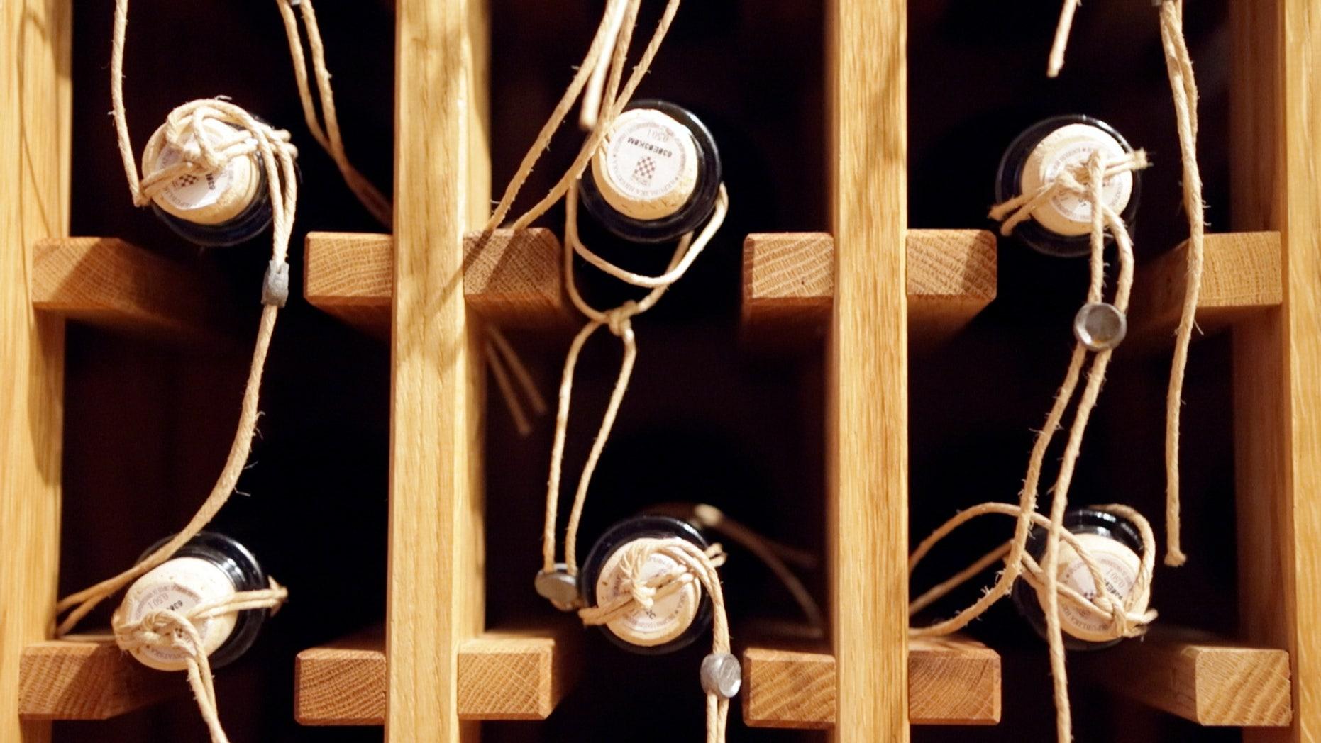 April 27, 2013: Bbottles of local made sweet wine Prosek are seen on a shelf in a wine cellar in Jelsa, southern Croatia.