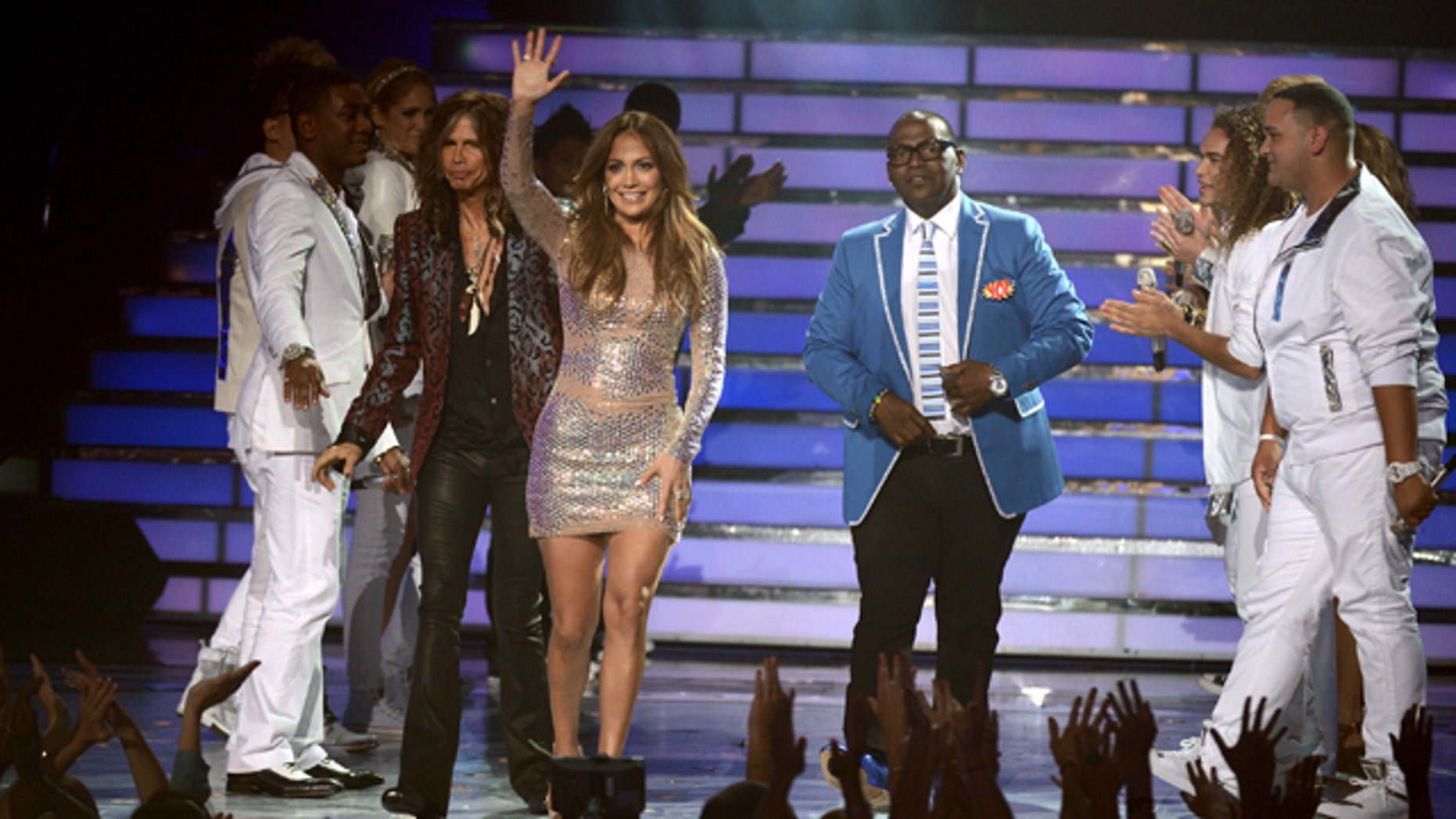 """LOS ANGELES, CA - MAY 23:  Judges Steven Tyler, Jennifer Lopez, and Randy Jackson greet the contestants onstage during Fox's """"American Idol 2012"""" results show at Nokia Theatre L.A. Live on May 23, 2012 in Los Angeles, California.  (Photo by Mark Davis/Getty Images)"""