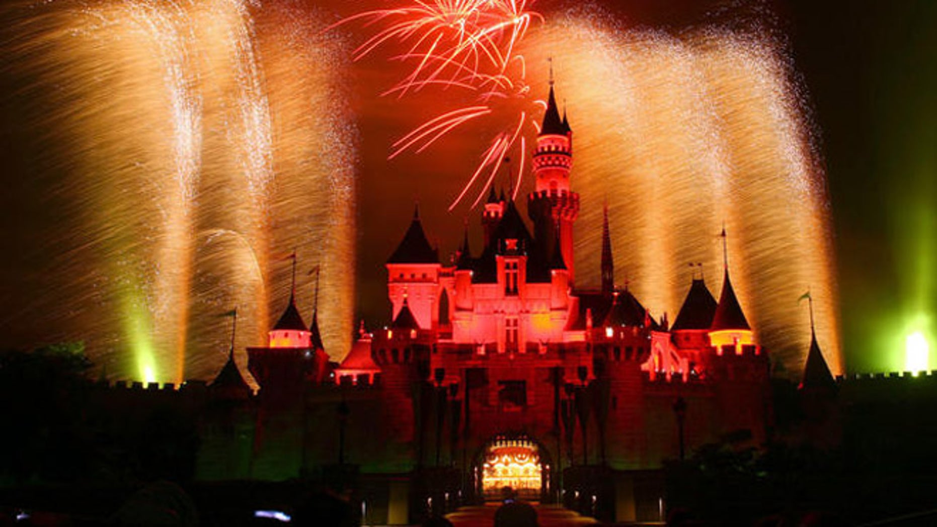 In this photo provided by Disney, fireworks light up the sky above Sleeping Beauty Castle at Hong Kong Disneyland Sept. 12, 2006 on the vacation resort's first birthday.  Hong Kong Disneyland opened Sept. 12, 2005.  (AP Photo/Disney, Gary Kwok) **NO SALES**