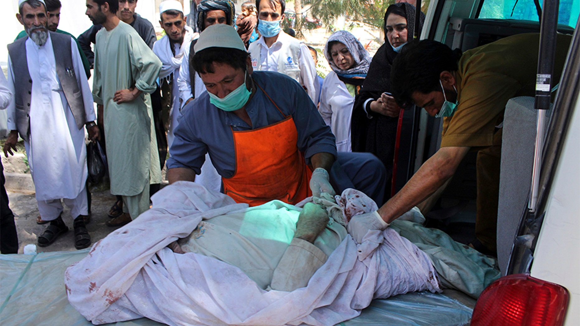 July 31, 2018: Medical personnel transport the body of a bombing victim by ambulance, at a hospital in Herat, Afghanistan.