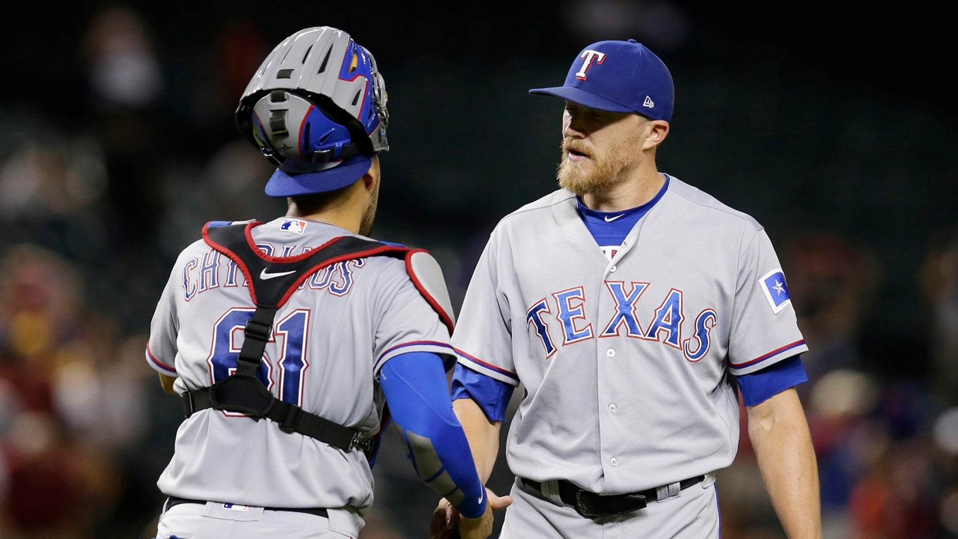 Texas Rangers pitcher Jake Diekman was traded to the Arizona Diamondbacks on Tuesday, and all he had to do was take a golf cart to the other side of Chase Field.