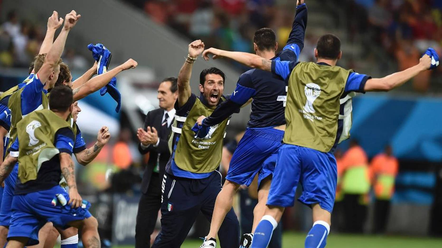 Italian goalie Gianluigi Buffon, face to camera, and coach Cesare Prandelli, center, celebrate with the team after the group D World Cup soccer match between England and Italy at the Arena da Amazonia in Manaus, Brazil, Saturday, June 14, 2014. Italy won the match 2-1. (AP Photo/Fabio Ferrari)
