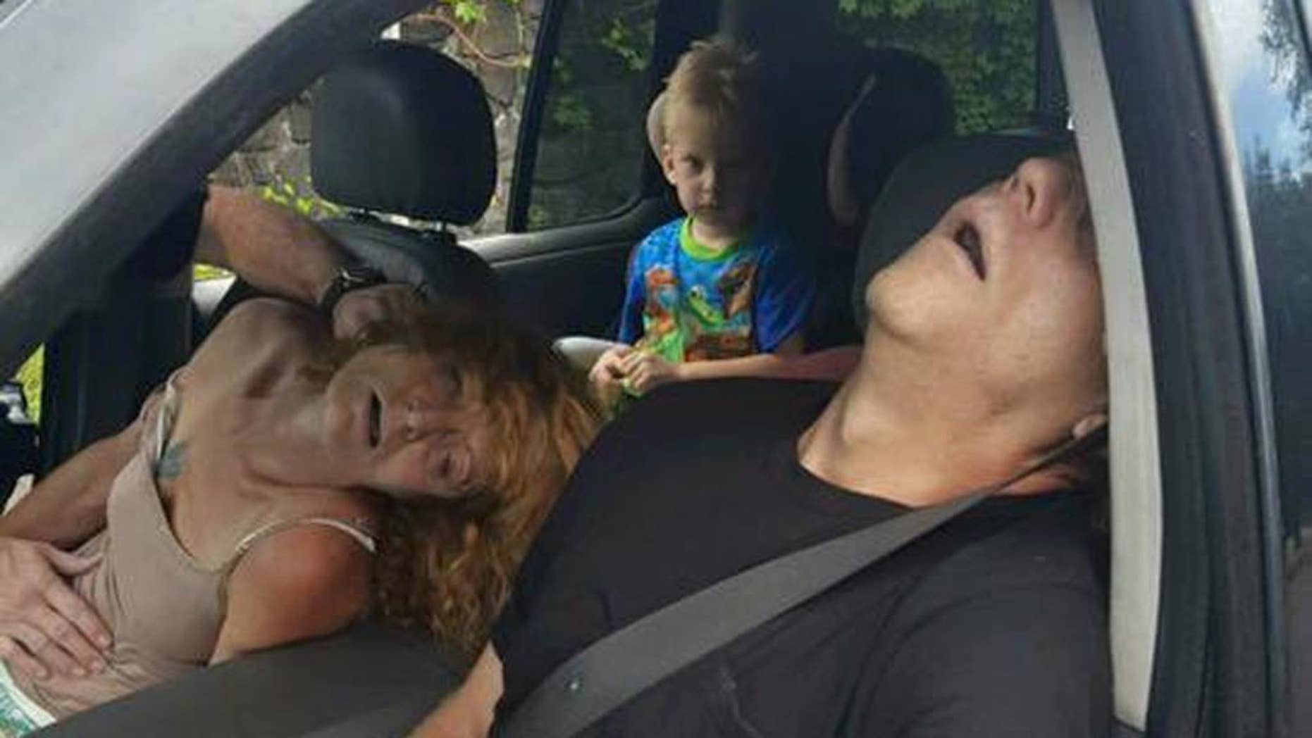 FILE - In this Wednesday, Sept. 7, 2016, file photo, released by the East Liverpool Police Department, a young child sits in a vehicle behind his grandmother, Rhonda Pasek and her boyfriend, James Acord, both of whom are unconscious from a drug overdose, in East Liverpool, Ohio. An Ohio judge has turned over the custody of the boy. A Columbiana County Juvenile Court administrator told The Associated Press that the boy's great uncle and great aunt petitioned the court for custody, which was granted by a judge on Monday, Sept. 12. (East Liverpool Police Department via AP, File)