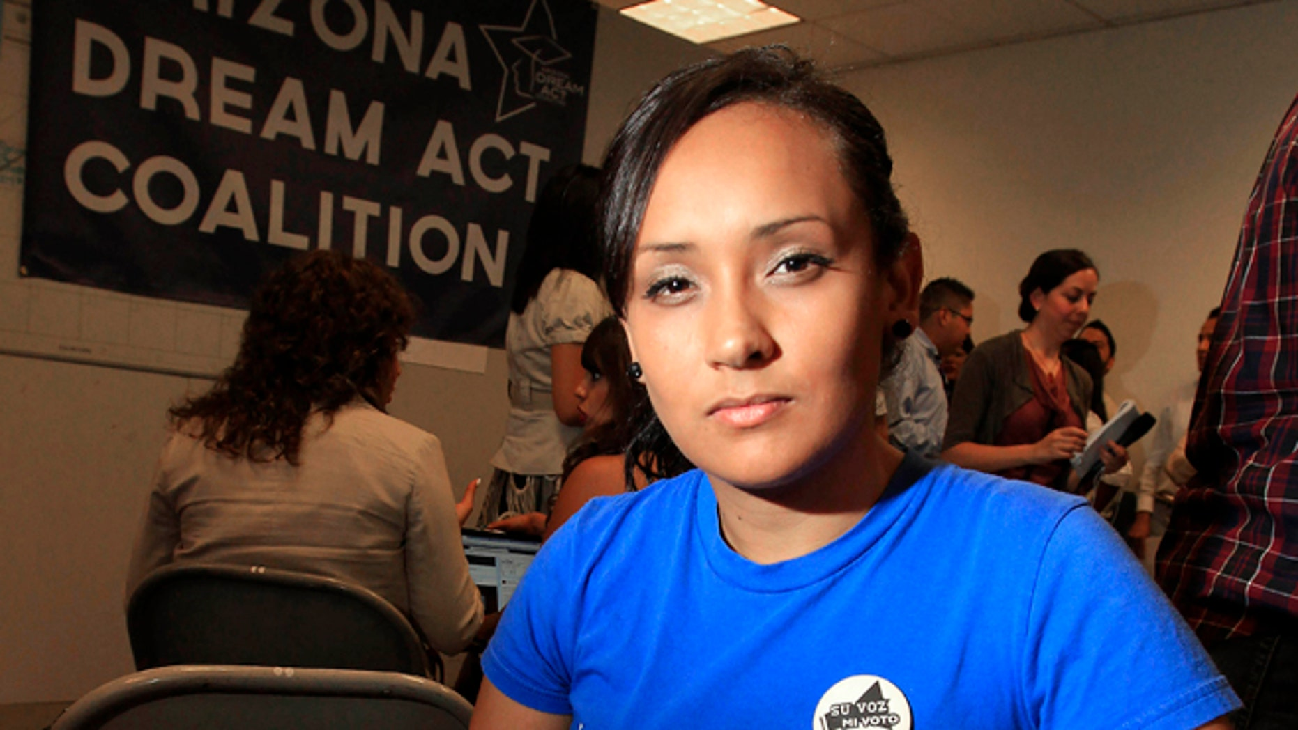 Erika Andiola poses for a portrait at a site where people line up to get guidance on Deferred Action.