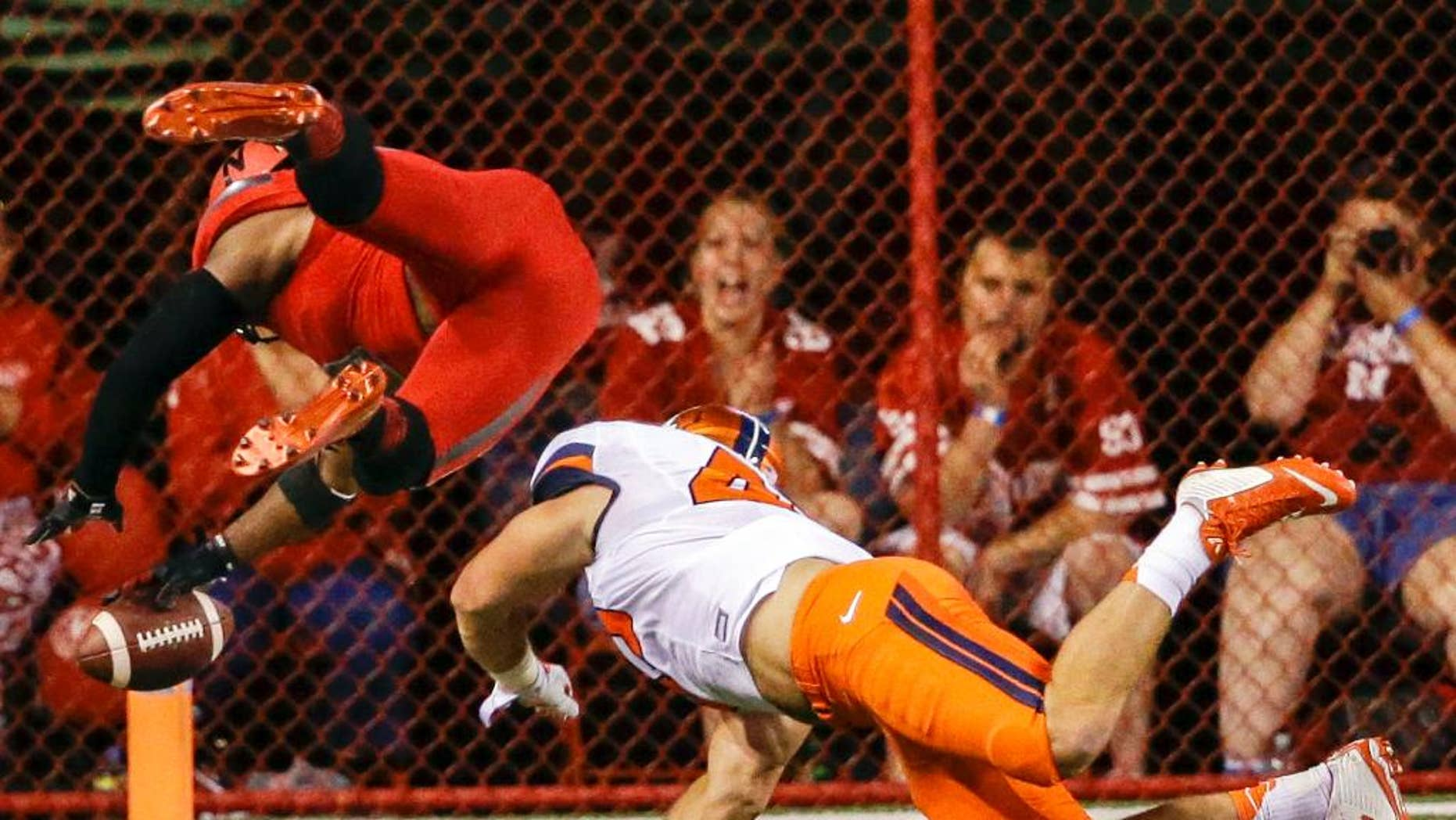 Nebraska running back Ameer Abdullah, left, leaps into the end zone for a touchdown past Illinois linebacker Mason Monheim in the first half of an NCAA college football game in Lincoln, Neb., Saturday, Sept. 27, 2014. (AP Photo/Nati Harnik)