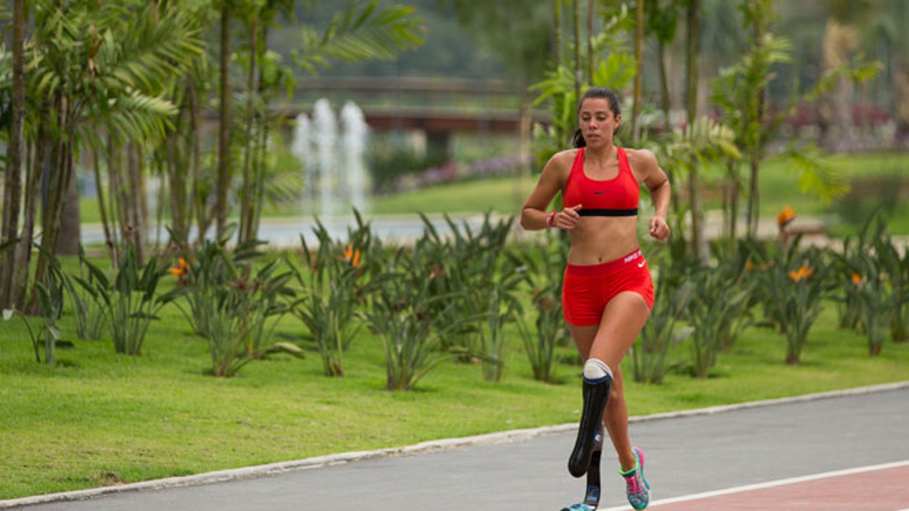 An athlete takes a run on the track in the Paralympic Village in preparation for the Paralympic Games in Rio de Janeiro, Brazil