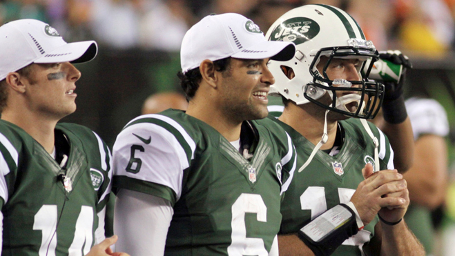 FILE - In this Aug. 10, 2012, file photo, New York Jets quarterbacks, from left, Greg McElroy, Mark Sanchez and Tim Tebow watch from the sidelines during the first half of a preseason NFL football game against the Cincinnati Bengals in Cincinnati. Jets coach Rex Ryan gathered his three quarterbacks Wednesday morning and told them he had made up his mind. It will be Sanchez and not McElroy orTebow on Sunday when the Jets take on the Jaguars in Jacksonville.(AP Photo/Tom Uhlman, File)