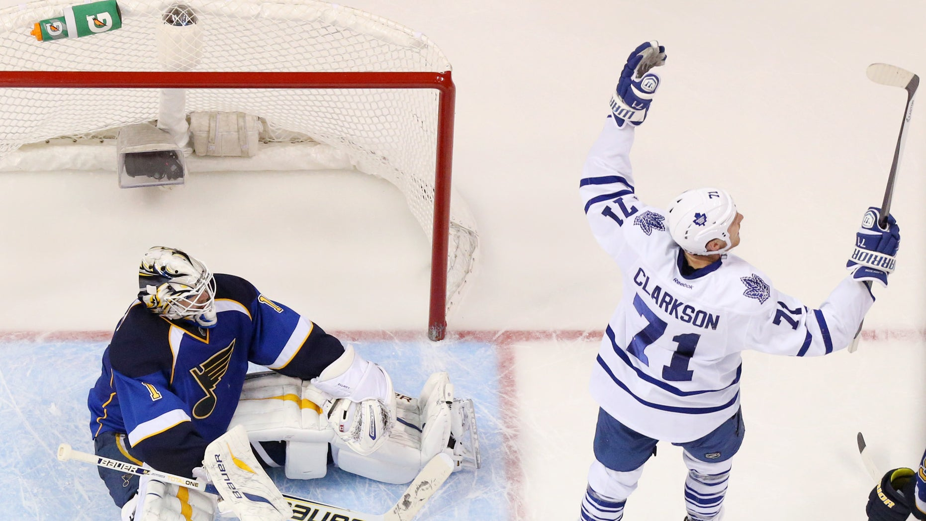 Toronto Maple Leafs right wing David Clarkson (right) celebrates after teammate James van Riemsdyk scored on a deflection past St. Louis Blues goaltender Brian Elliott (left) in third period action during a game between the St. Louis Blues and the Toronto Maple Leafs on Thursday Dec. 12 2013, in St. Louis. (AP Photo/St. Louis Post-Dispatch, Chris Lee)