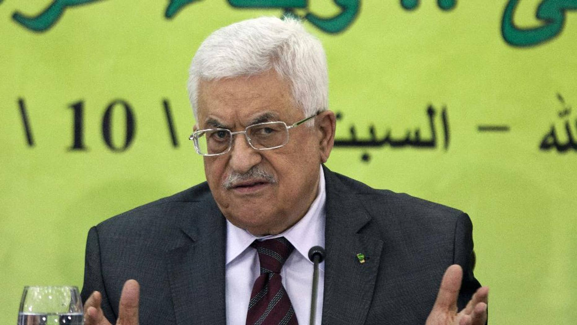 FILE - In this Oct. 18, 2014 file photo, Palestinian President Mahmoud Abbas speaks during a meeting of the Fatah revolutionary council in the West Bank city of Ramallah. Abbas has threatened to stop security coordination with Israel if the country continues to withhold millions of dollars of Palestinian tax revenue, a senior Palestinian official said Sunday, Feb. 22, 2015. Nabil Shaath said President Mahmoud Abbas warned European leaders on a trip to Europe last week that Palestinian officials would discuss the matter during a Palestinian central council meeting next week. (AP Photo/Majdi Mohammed, File)