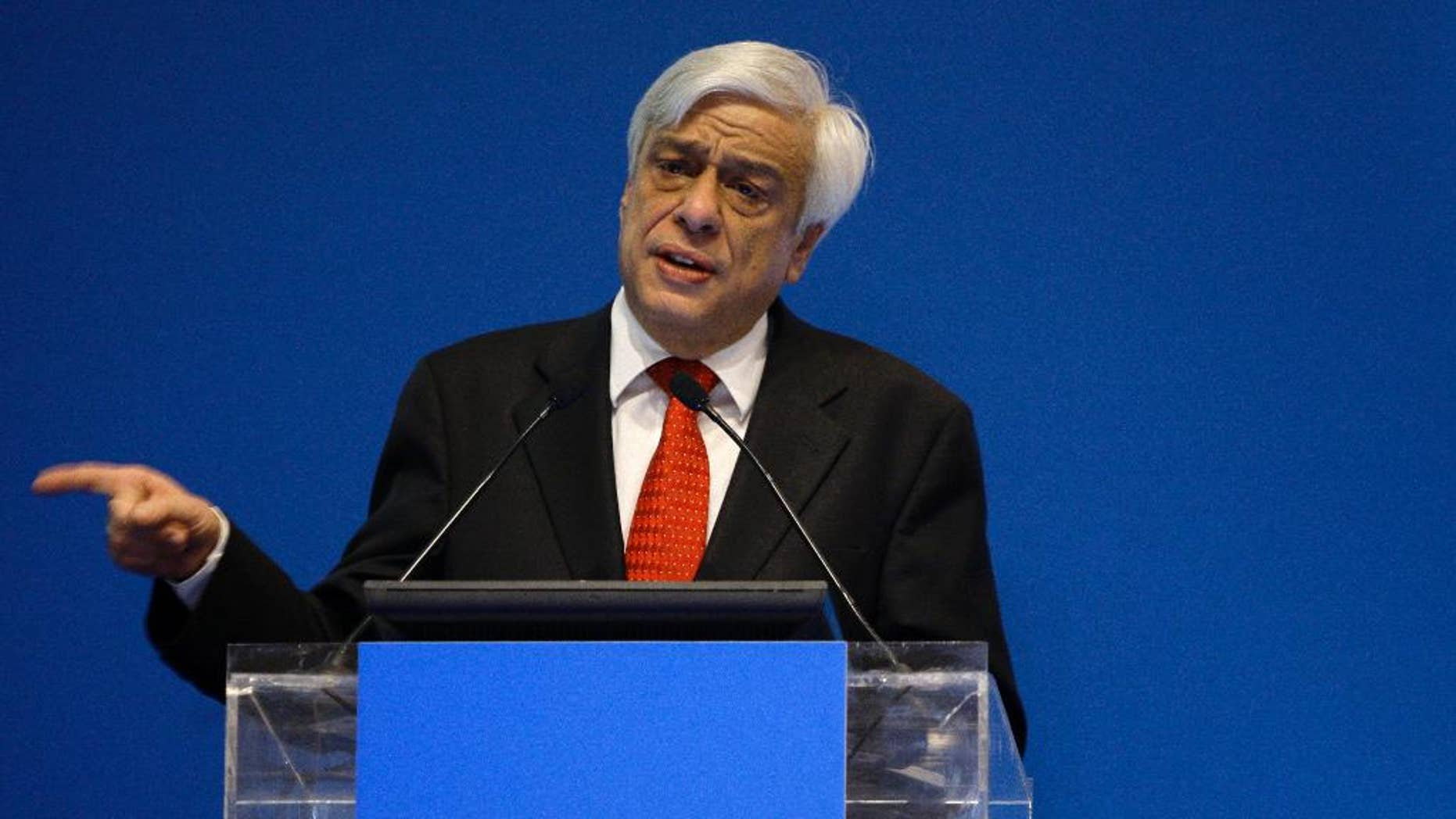 FILE - In this photo taken on Tuesday, March 17, 2009, Greek Interior Minister Prokopis Pavlopoulos speaks during Exposec international security conference, in Zappeion hall, Athens. Greece's Prime Minister Alexis Tsipras announced on Tuesday, Feb. 17, 2015 that his party would endorse former conservative interior minister Prokopis Pavlopoulos as candidate for the country's new president. (AP Photo/Petros Giannakouris, File)