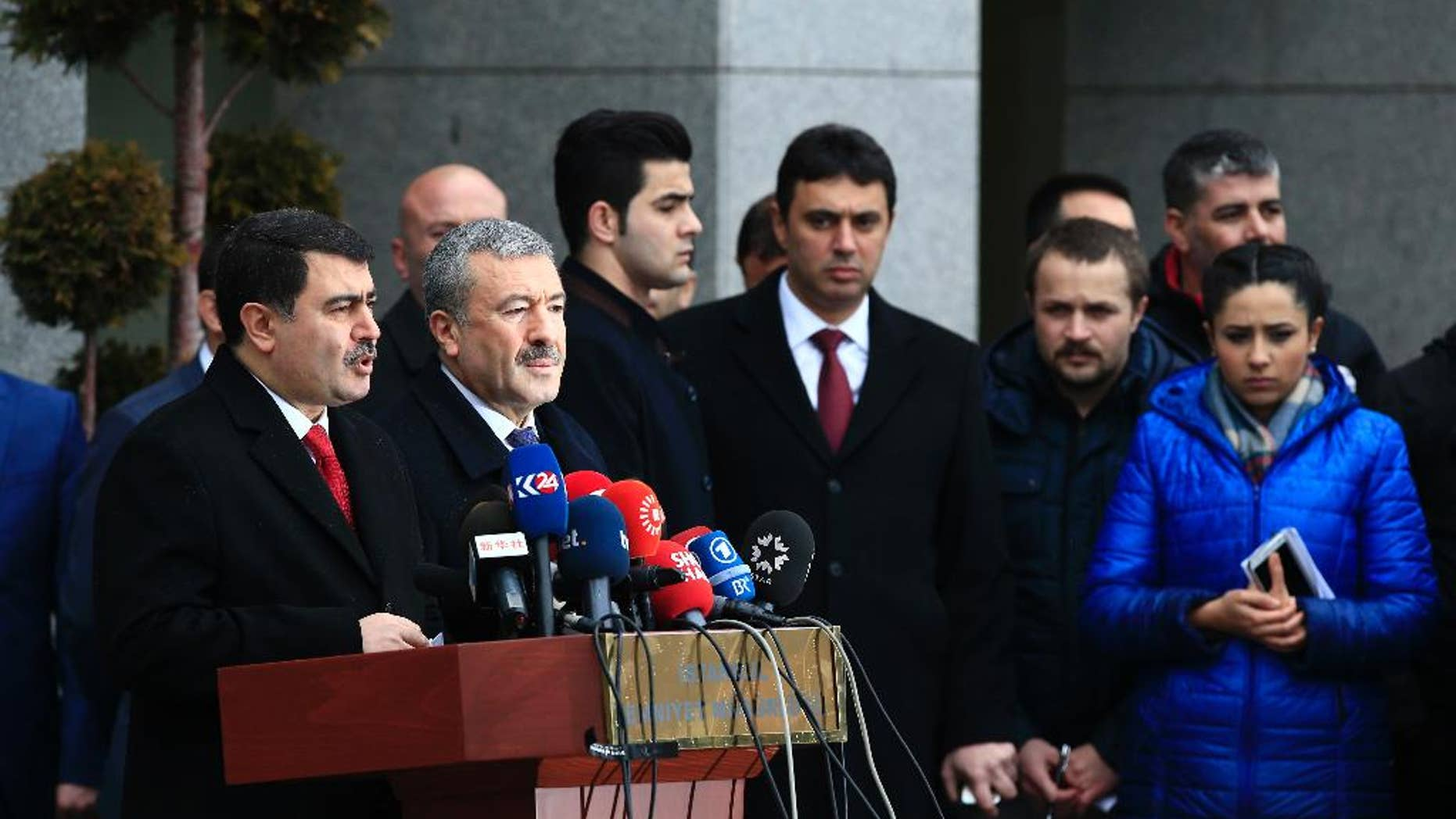 Istanbul Gov. Vasip Sahin, left, accompanied by Police Chief Mustafa Caliskan, second from left, talks to the media during a news conference regarding the arrest of a suspect of New Year's nightclub attack in Istanbul, Tuesday, Jan. 17, 2017. Turkish officials on Tuesday confirmed that the gunman who carried out the deadly New Year's attack on an Istanbul nightclub, which was claimed by the Islamic State group, has been detained. (AP Photo/Lefteris Pitarakis)
