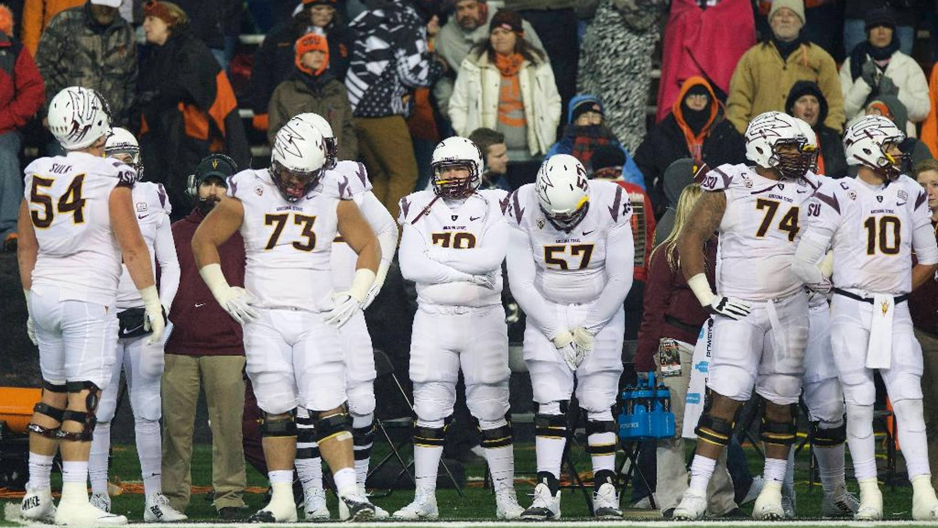 The Arizona State football team watch from the sidelines as time runs down during an NCAA college football game against Oregon State in Corvallis, Or., Saturday, Nov. 15, 2014. The Beavers beat the Sun Devils 35-27. (AP Photo/Troy Wayrynen)