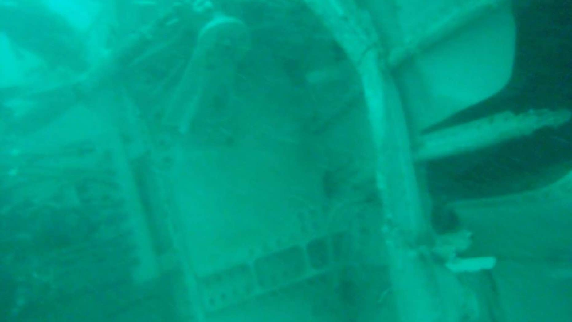 FILE - In this undated underwater file photo released by Indonesia's National Search And Rescue Agency (BASARNAS) on Wednesday, Jan. 7, 2015, the part of the wreckage that BASARNAS identified as of the ill-fated AirAsia Flight 8501, is seen in the waters of the Java Sea, Indonesia. The second attempt to lift the fuselage of the crashed AirAsia jetliner failed Sunday, Jan. 25, 2015 as the wreckage sank back to the ocean floor when a rope linking the lifting balloons broke. Navy spokesman Manahan Simorangkir said strong current was the main obstacle. The rope had been fastened and linked to a ship, but broke again as the fuselage was lifted. (AP Photo/BASARNAS, File)