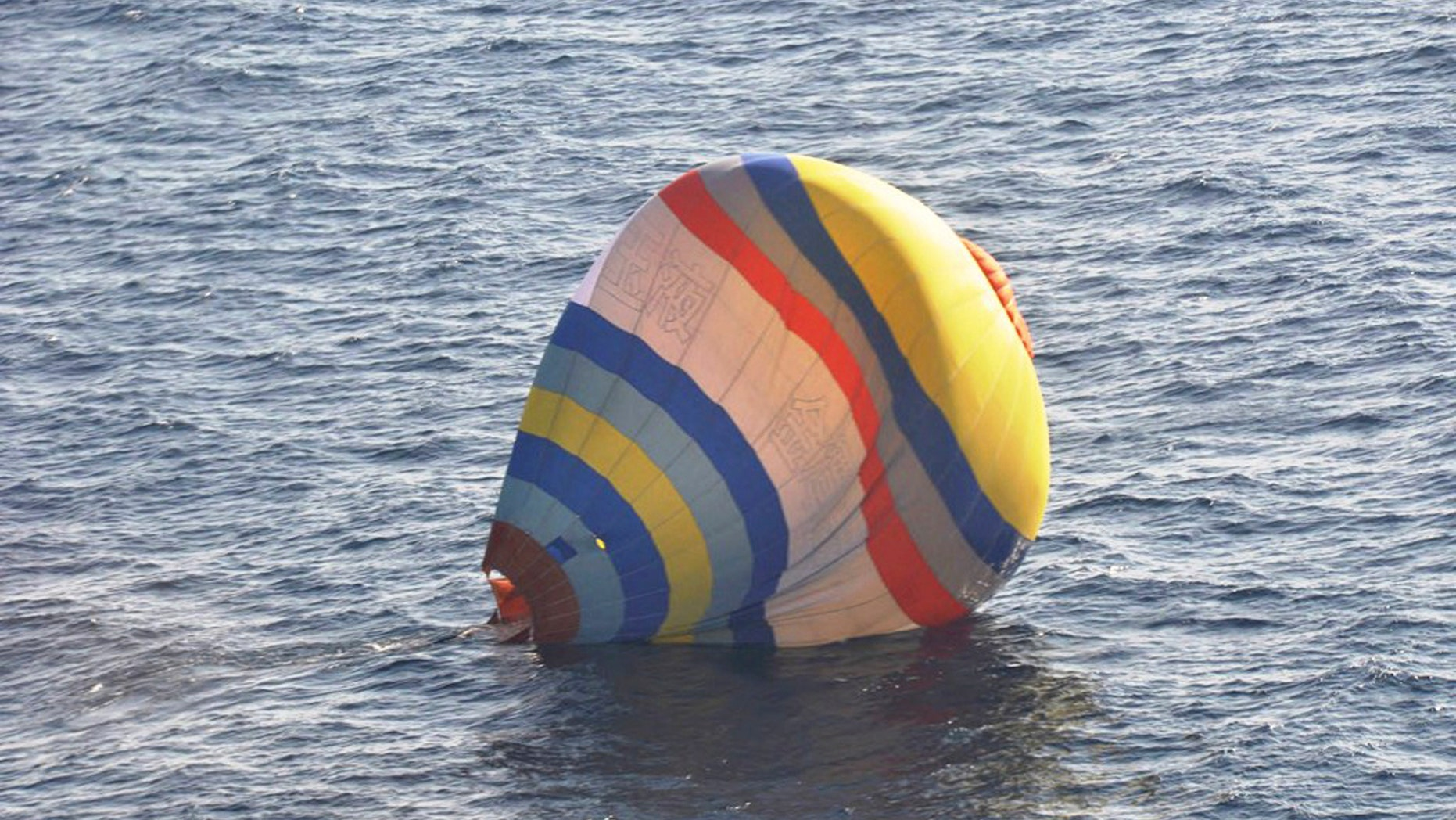 This Wednesday, Jan. 1, 2013 photo released by  Japan's 11th Regional Coast Guard shows a hot-air balloon in which the Coast Guard says a  Chinese cook took a ride, in waters near the East China Sea islands called Senkaku by Japan and Diaoyu by China. Xu Shuaijun, 35, crashed Wednesday after hitting turbulence as he approached the islands claimed by both China and Japan has been rescued by Japan's Coast Guard after crashing into the sea. (AP Photo/Japan's 11th Regional Coast Guard)