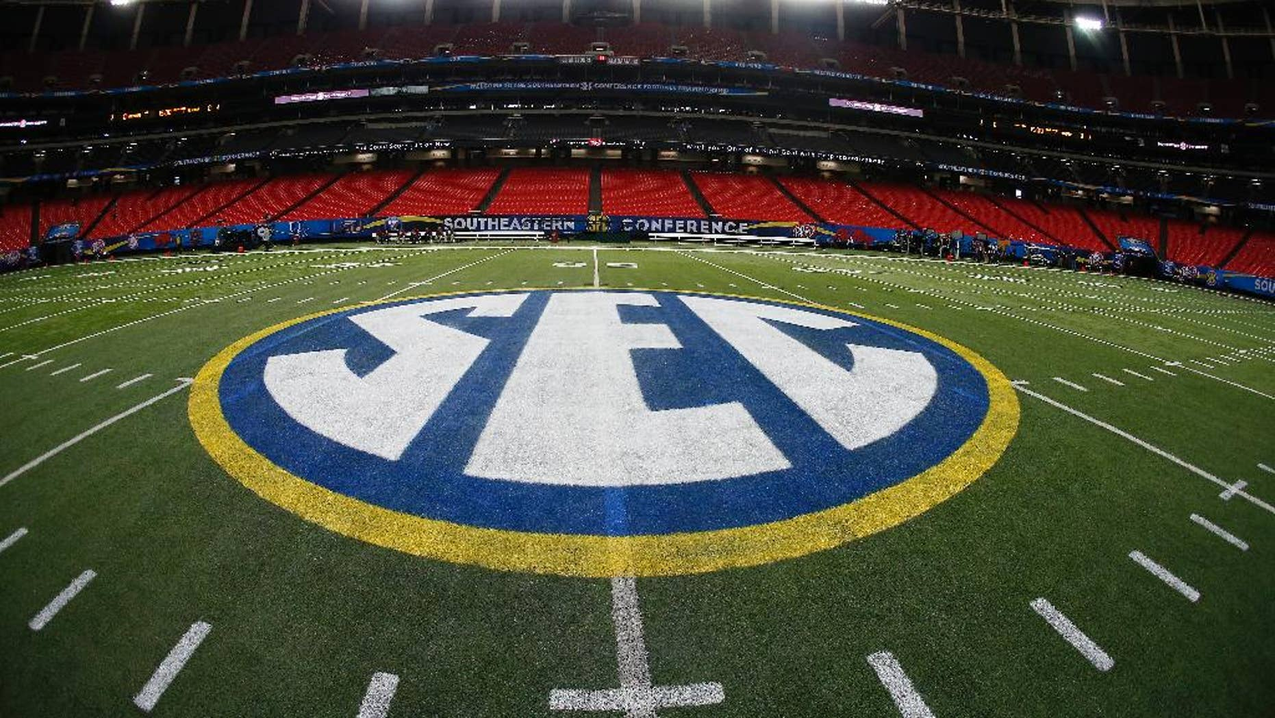 The SEC logo is seen Friday, Dec. 5, 2014, in Atlanta, ahead of the Southeastern Conference championship football game between Alabama and Missouri held Saturday. (AP Photo/John Bazemore)