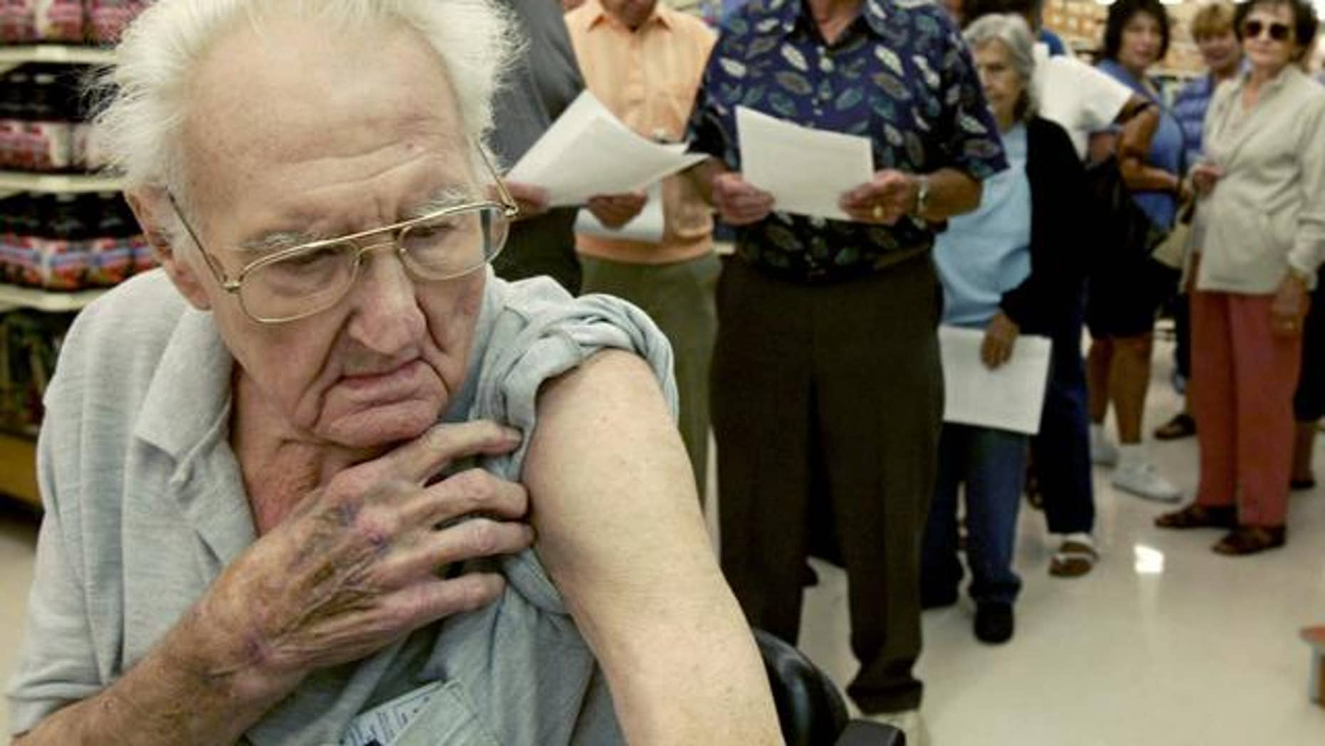 Pete Jacksen, 86, waits in line to get a flu shot at Pavilions pharmacy in Monrovia, Calif., Thursday, Oct. 7, 2004. Health officials nationwide are urging healthy adults and schoolchildren to skip the shot because British regulators have shut down the major flu-shot supplier Chiron on Tuesday, citing manufacturing problems.(AP Photo/Nick Ut)