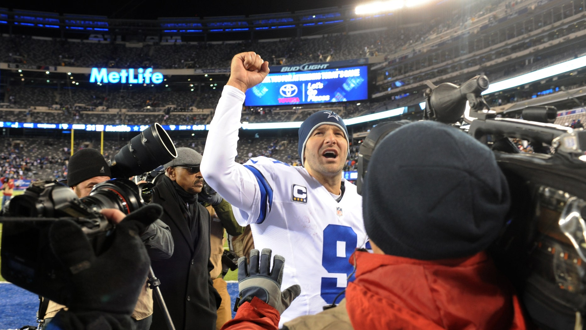 File - In this Nov. 24, 2013 file photo, Dallas Cowboys quarterback Tony Romo (9) gestures while leaving the field after defeating the New York Giants 24-12 in an NFL football game, in East Rutherford, N.J. The winter blast that hit North Texas forced the Cowboys indoors when they were hoping to keep working outside in preparation for a bitterly cold Monday night in Chicago. The Cowboys don't mind practicing in the elements because it worked pretty well leading up to a frigid win at the New York Giants two weeks ago. (AP Photo/Bill Kostroun, File)