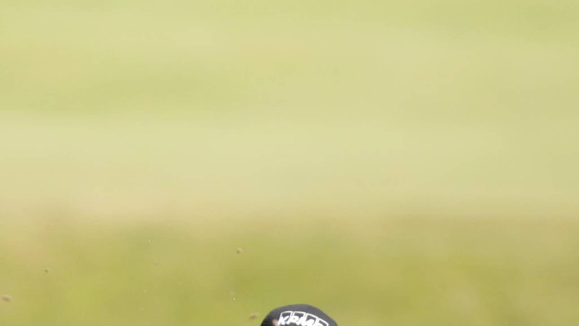 United States' Phil Mickelson plays to the 11th green during the second round of the British Open Golf Championship at the Old Course, St. Andrews, Scotland, Friday, July 17, 2015. (AP Photo/Alastair Grant)