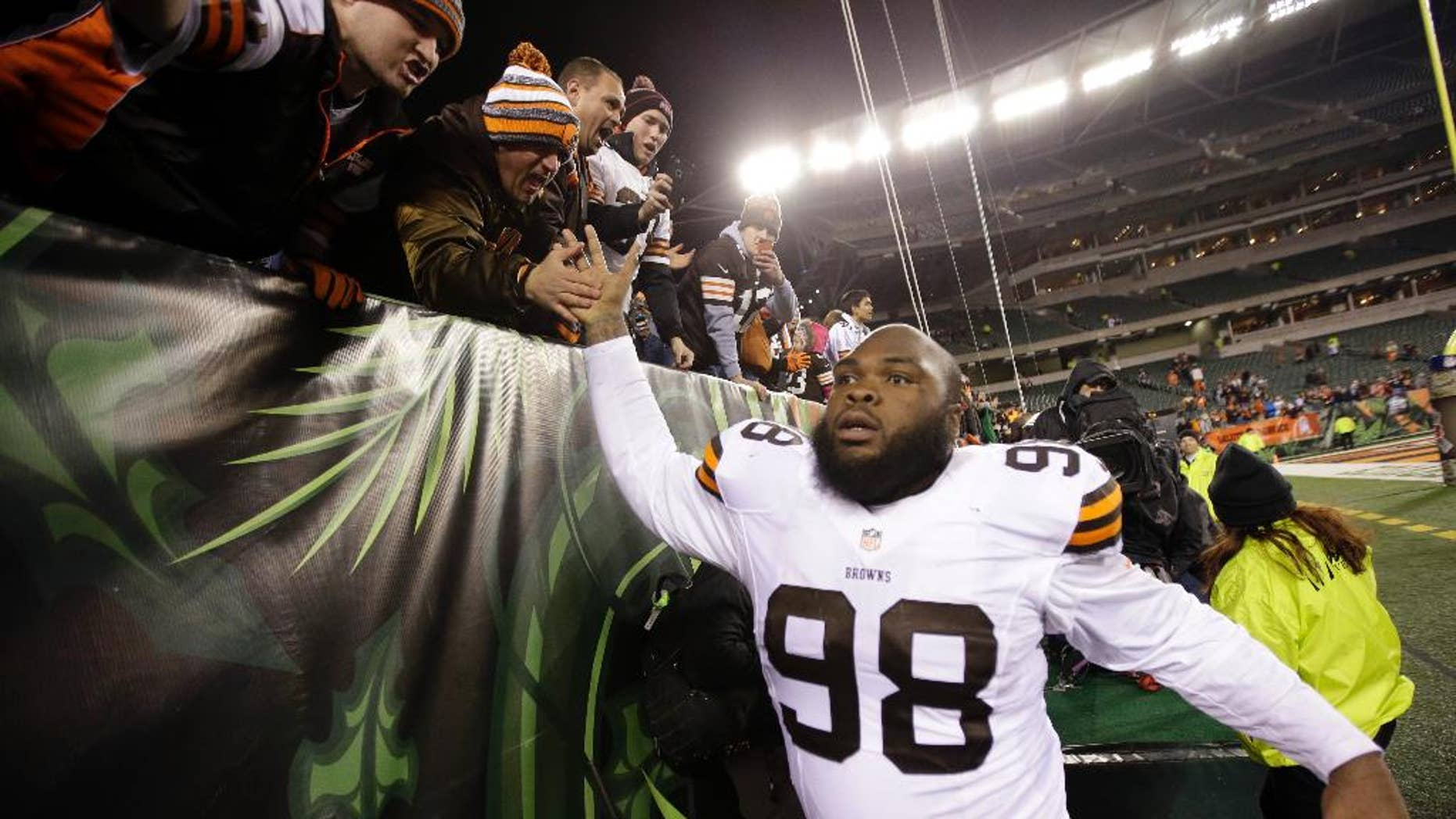 Cleveland Browns defensive end Phillip Taylor (98) celebrates after the Browns defeated the Cincinnati Bengals 24-3 in an NFL football game Thursday, Nov. 6, 2014, in Cincinnati. (AP Photo/AJ Mast)