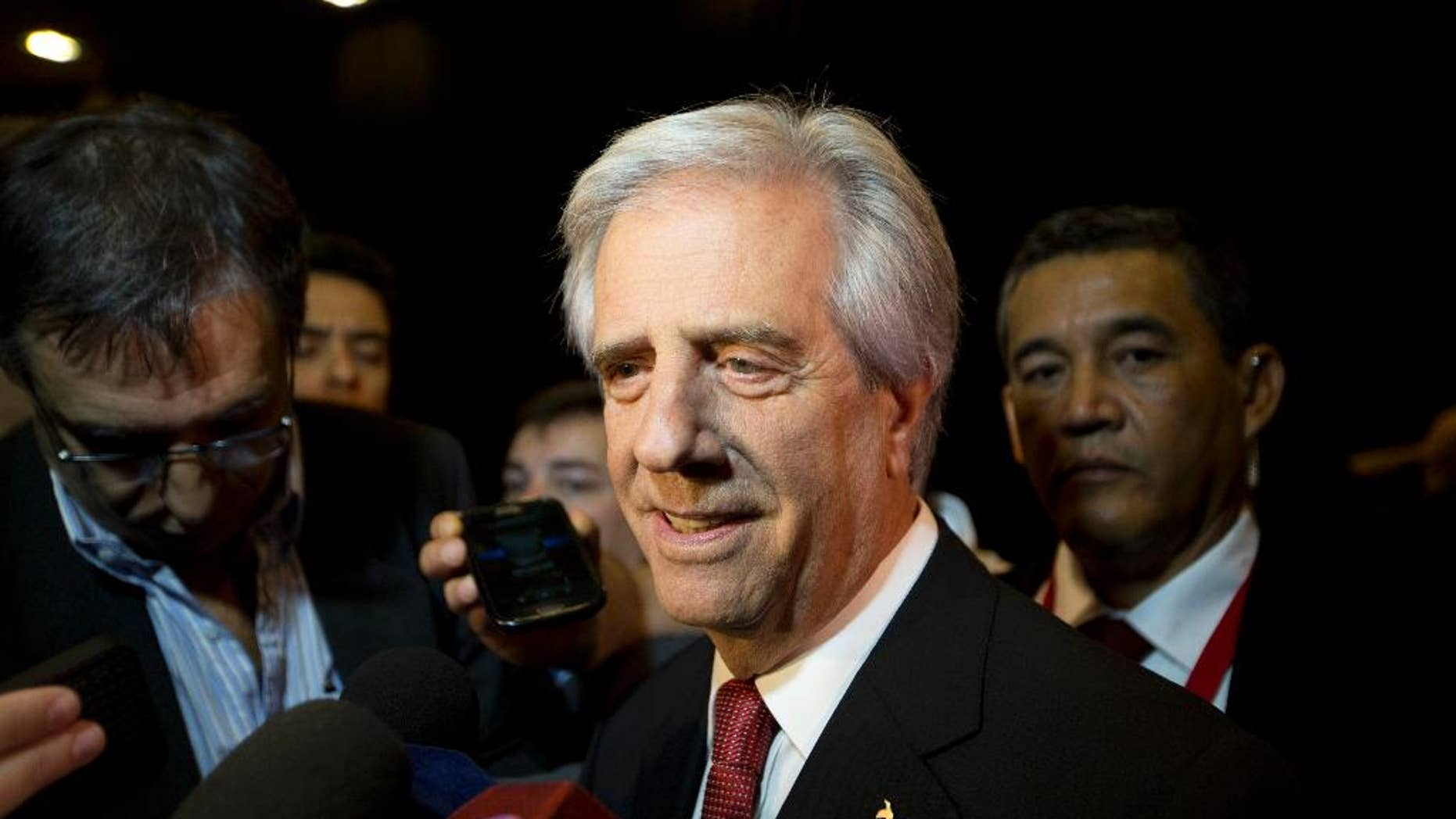 Uruguay's President Tabare Vazquez speaks to reporters as he arrives to the CEO Summit of the Americas in Panama City, Friday, April 10, 2015.  The second CEO Summit organized by Panama's government and the Inter-American Development Bank, gathers business and political leaders, just before the start of the VII Summit of the Americas. (AP Photo/Moises Castillo)