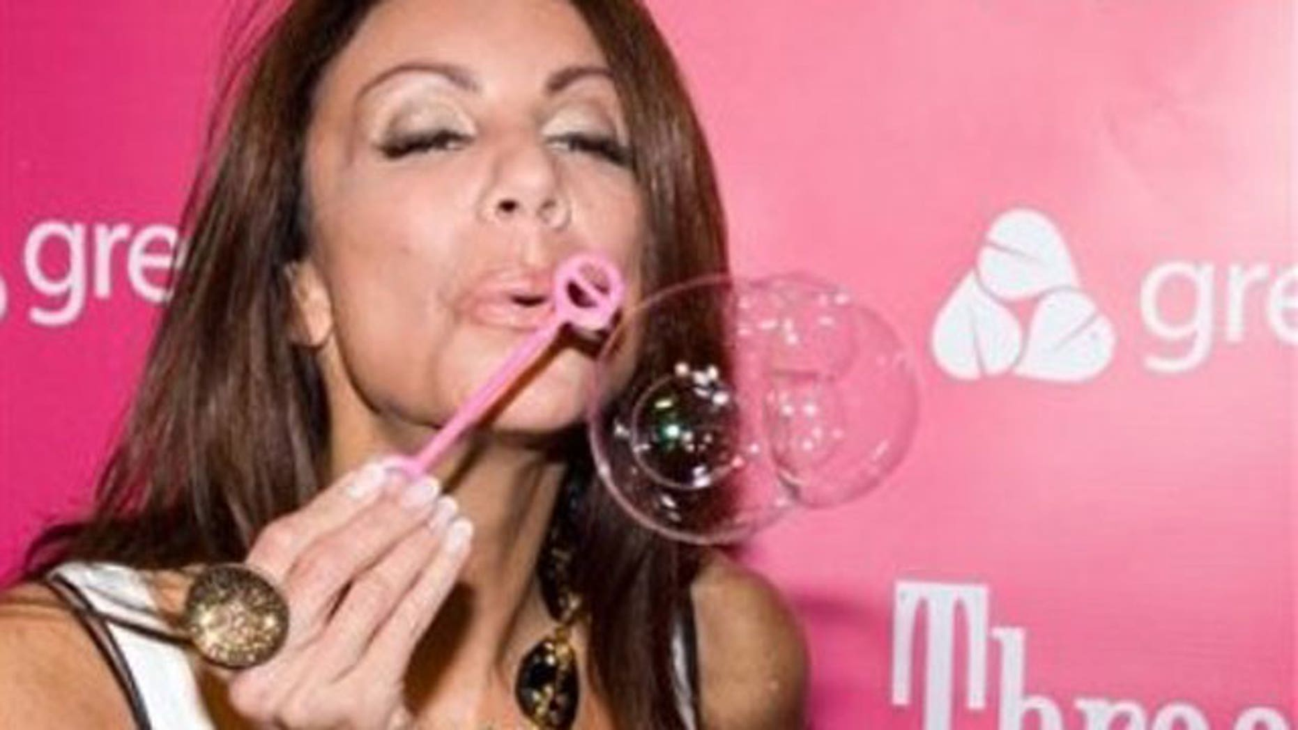 Danielle Staub blows bubbles at Three-O Bubble Vodka launch party at Greenhouse in New York, Thursday, July 9, 2009. (AP)