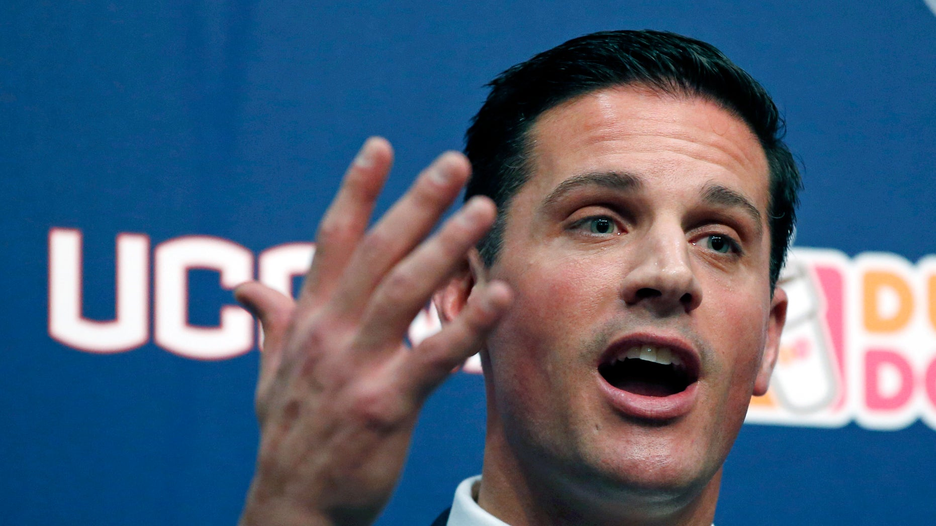 In this Dec. 12, 2013 file photo, Bob Diaco, former Notre Dame defensive coordinator, speaks after being introduced as Connecticut's new head football coach on campus in Storrs, Conn. Diaco acknowledges he's detail oriented. Two months into the job, there have been some changes at UConn's Shenkman football training center, all ordered by Diaco, who spent some time with a pad and pen diagramming every room in the building. UConn's spring practice begins on March 10. (AP Photo/Elise Amendola, File)