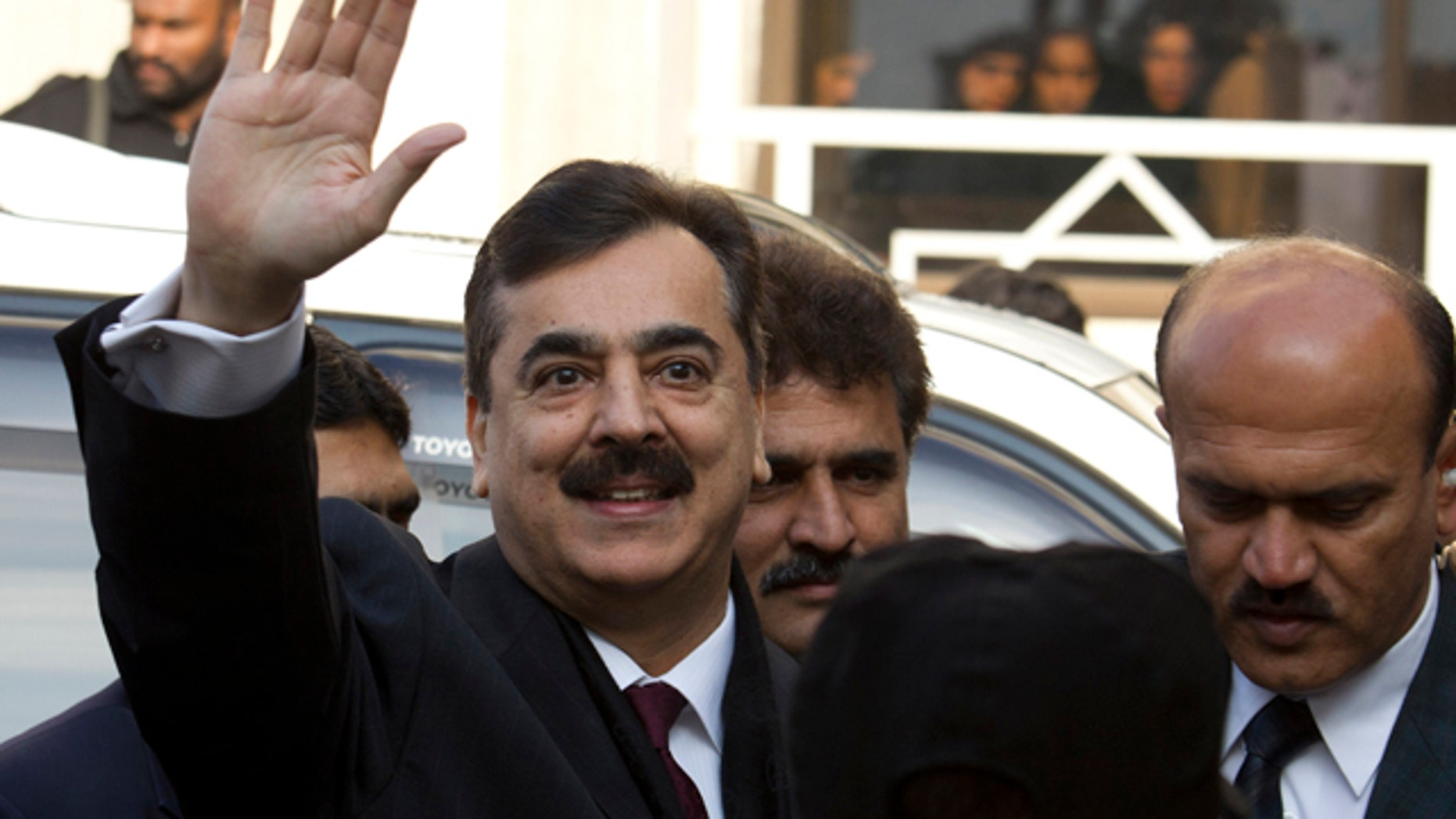 Jan. 19: Pakistani Prime Minister Yousuf Raza Gilani waves at the Supreme Court in Islamabad.