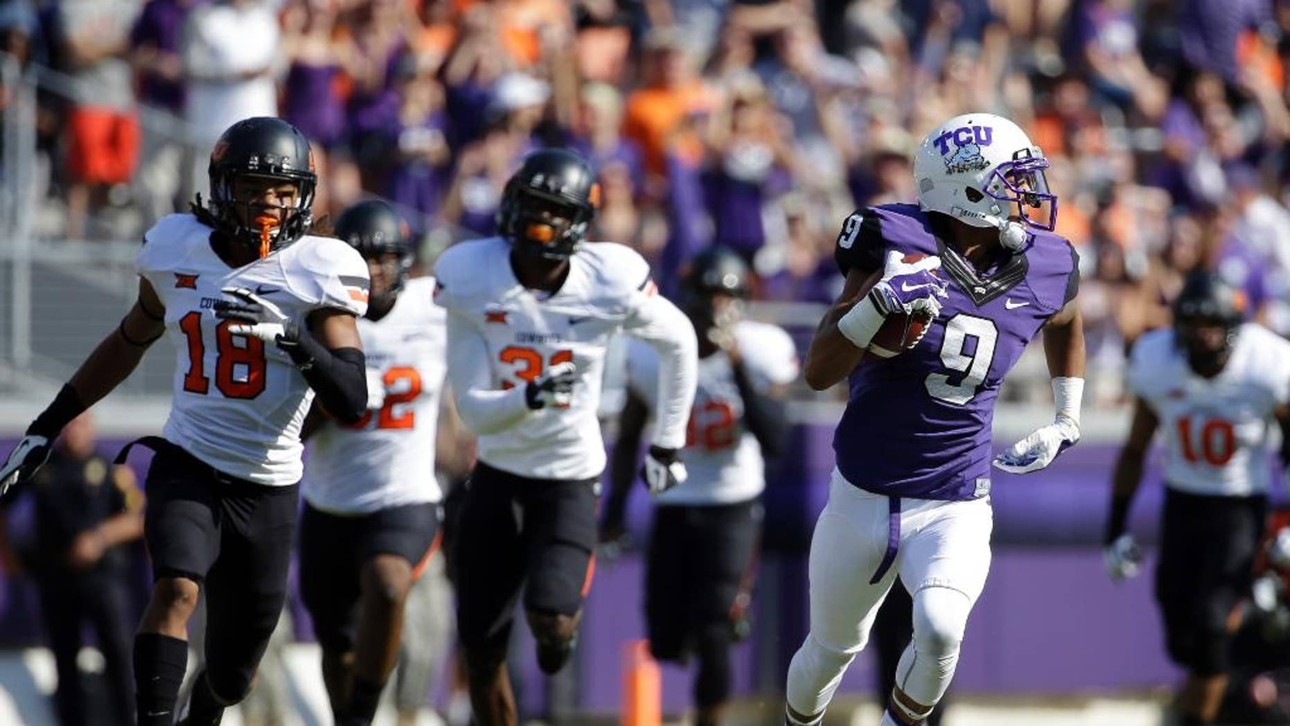 Oklahoma State cornerback Ramon Richards (18) and others give chase after TCU's Josh Doctson (9) after Doctson grabbed a pass and sprinted to the end zone for a score in the first half of an NCAA college football game, Saturday, Oct. 18, 2014, in Fort Worth, Texas. (AP Photo/Tony Gutierrez)