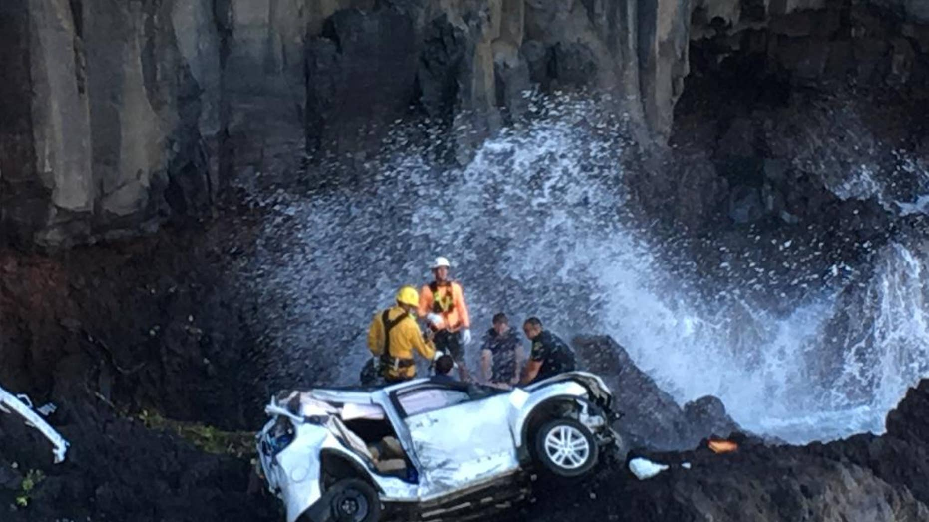Rescue workers respond to the scene of a car crash in Hawaii.