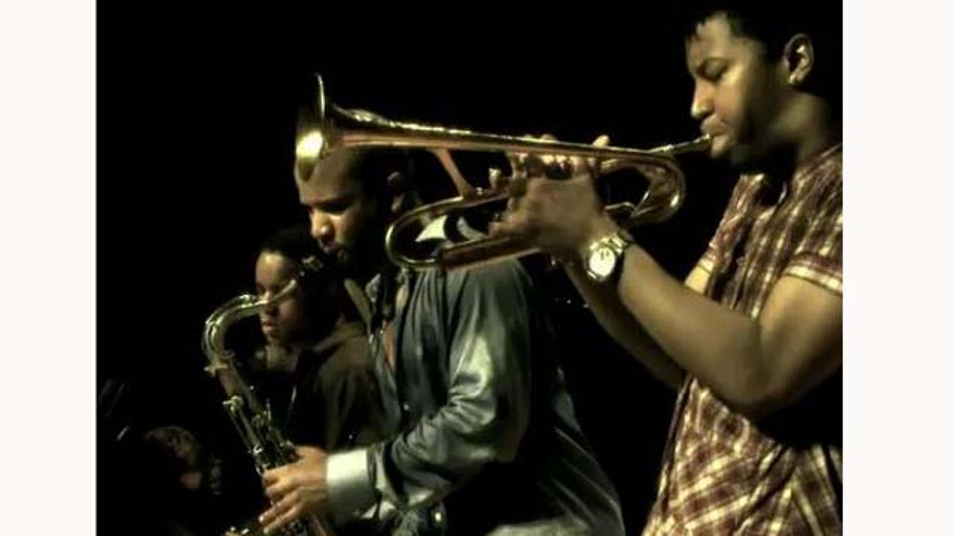 June 21, 2011: Musicians David Sánchez (middle) plays with his bandmates Christian Scott (R) and Stefon Harris (L).
