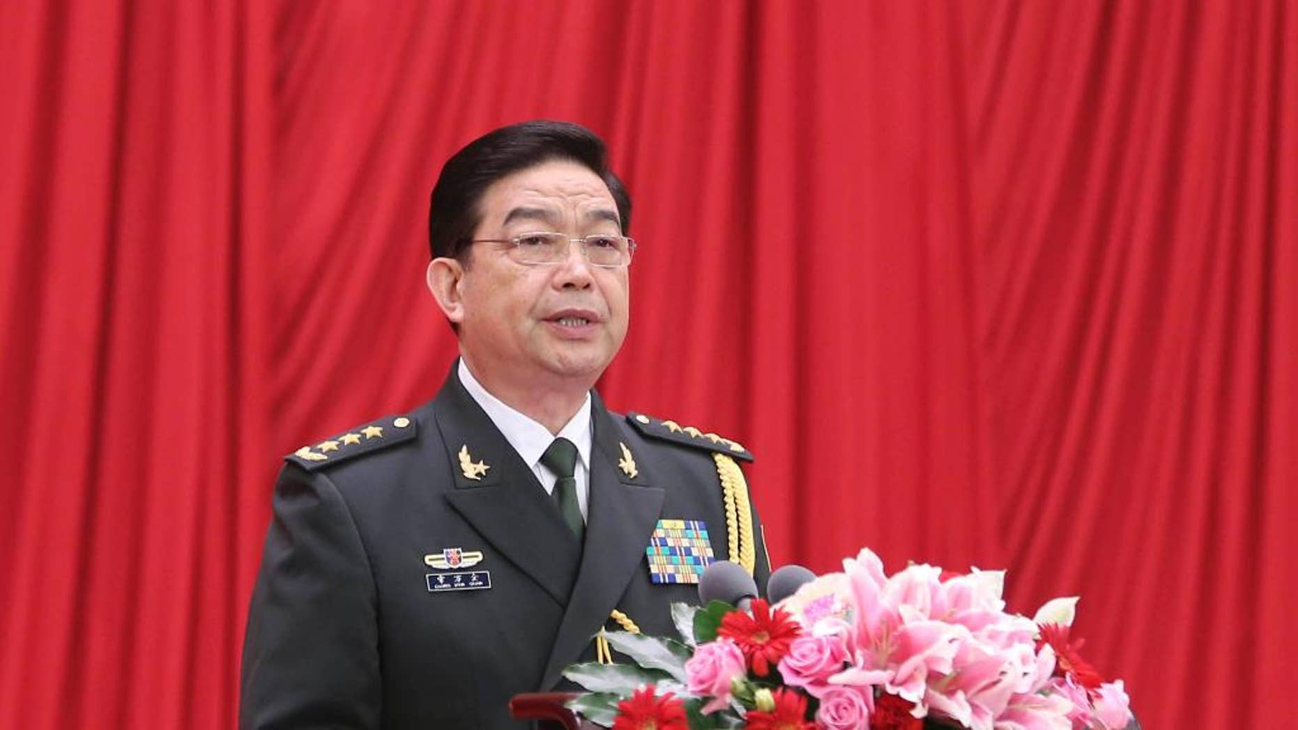 """In this Sunday, July 31, 2016 photo released by China's Xinhua News Agency, Chinese Defense Minister Chang Wanquan addresses a reception held by the Ministry of National Defense to celebrate the 89th anniversary of the founding of the Chinese People's Liberation Army (PLA) in Beijing. China has reiterated its commitment to defending its sovereignty amid new tensions over its territorial and maritime claims in the South China Sea. Chang told the reception on Sunday that China would firmly safeguard its """"state sovereignty, national security and development interests."""" """"Territorial integrity and maritime rights and interests will be defended,"""" Chang was cited as saying by the official Xinhua News Agency. (Ding Lin/Xinhua News Agency via AP) NO SALES"""