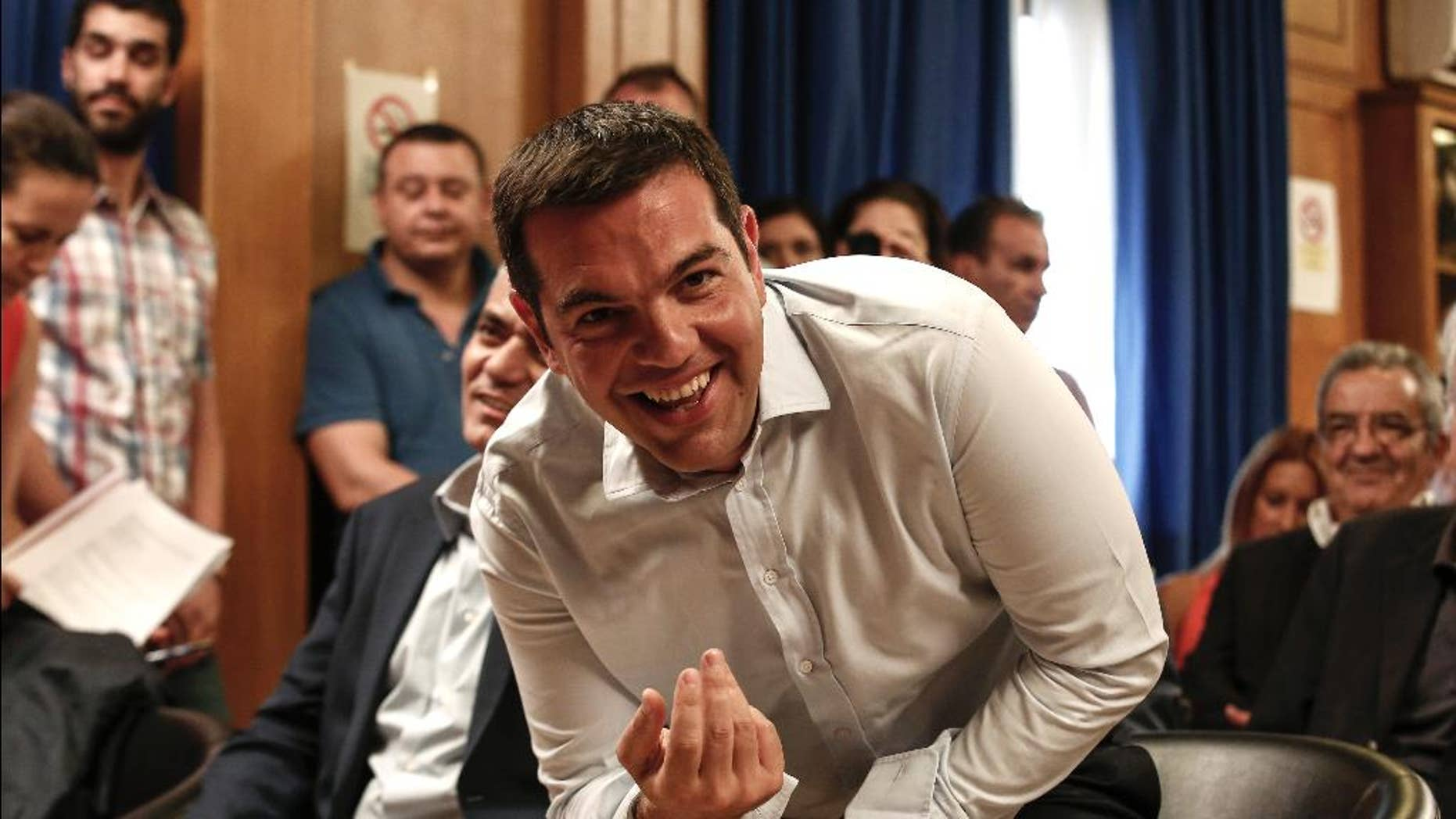 "Greece's Prime minister Alexis Tsipras takes his seat to attend a gathering at the Agriculture ministry in Athens, Greece, on Wednesday, Aug. 5, 2015. Tsipras said his country was at the ""final stage"" of talks for a new bailout, as his left-wing government on Wednesday rejected the idea of an extension in negotiations.  (AP Photo/Yorgos Karahalis)"
