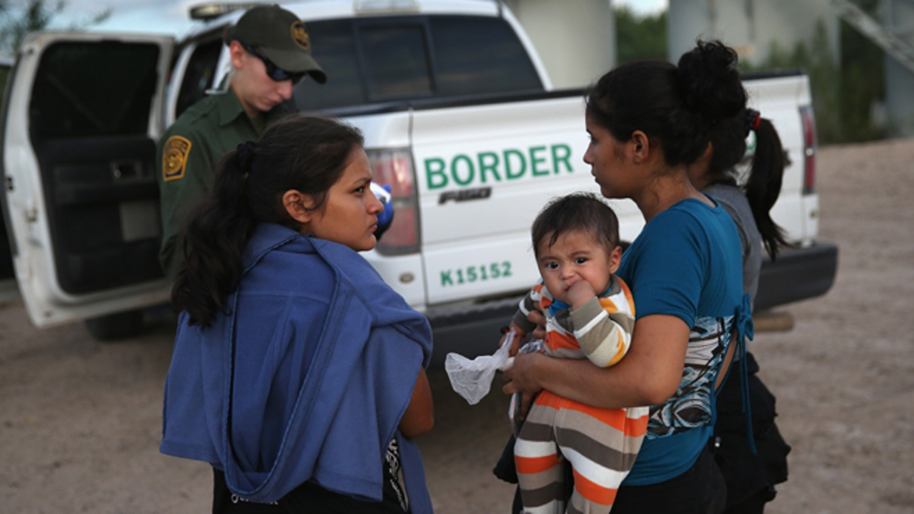 MCALLEN, TX - SEPTEMBER 08:  Families of Central American immigrants turn themselves in to U.S. Border Patrol agents after crossing the Rio Grande River from Mexico on September 8, 2014 to McAllen, Texas. Although the numbers of such immigrant families and unaccompanied minors have decreased from a springtime high, thousands continue to cross in the border illegally into the United States. The Rio Grande Valley sector is the busiest area for illegal border crossings, especially for Central Americans, into the U.S.  (Photo by John Moore/Getty Images)