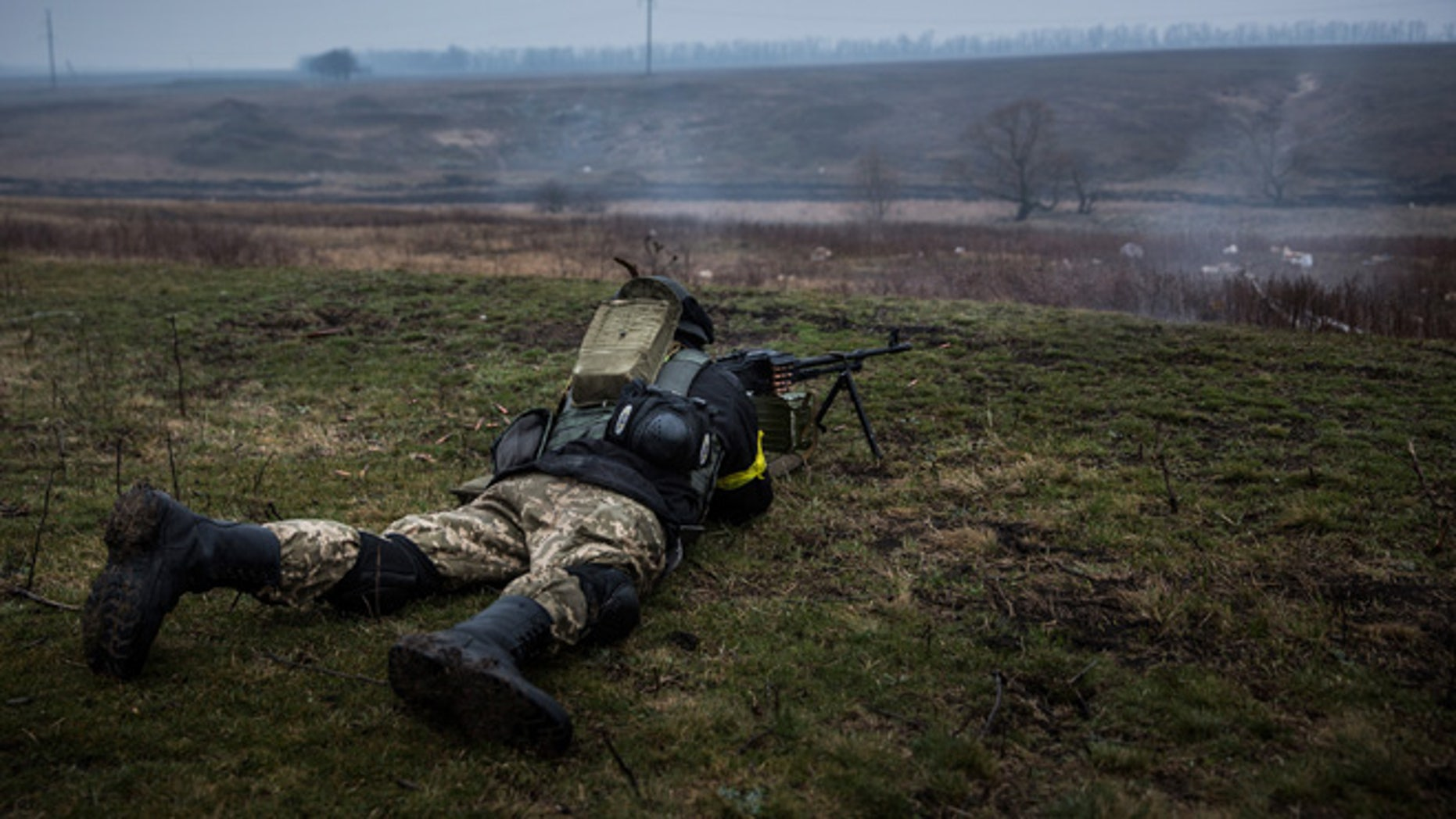 Ukrainian troops from Donbass battalion train with small arms on March 13, 2015 outside Mariupol, Ukraine.